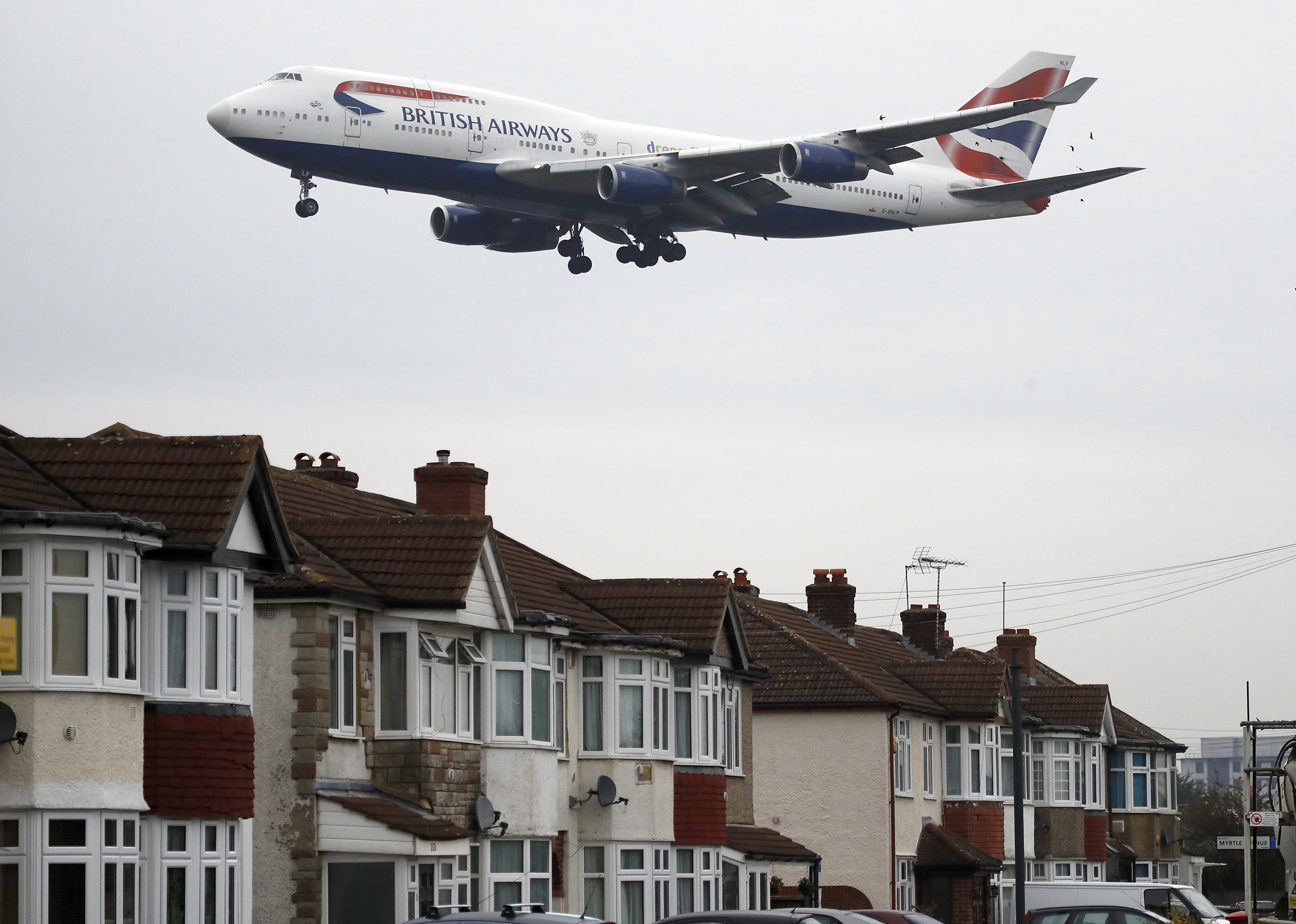 A plane approaches landing over the rooftops of nearby houses at Heathrow Airport in London, on Oct. 25, 2016.