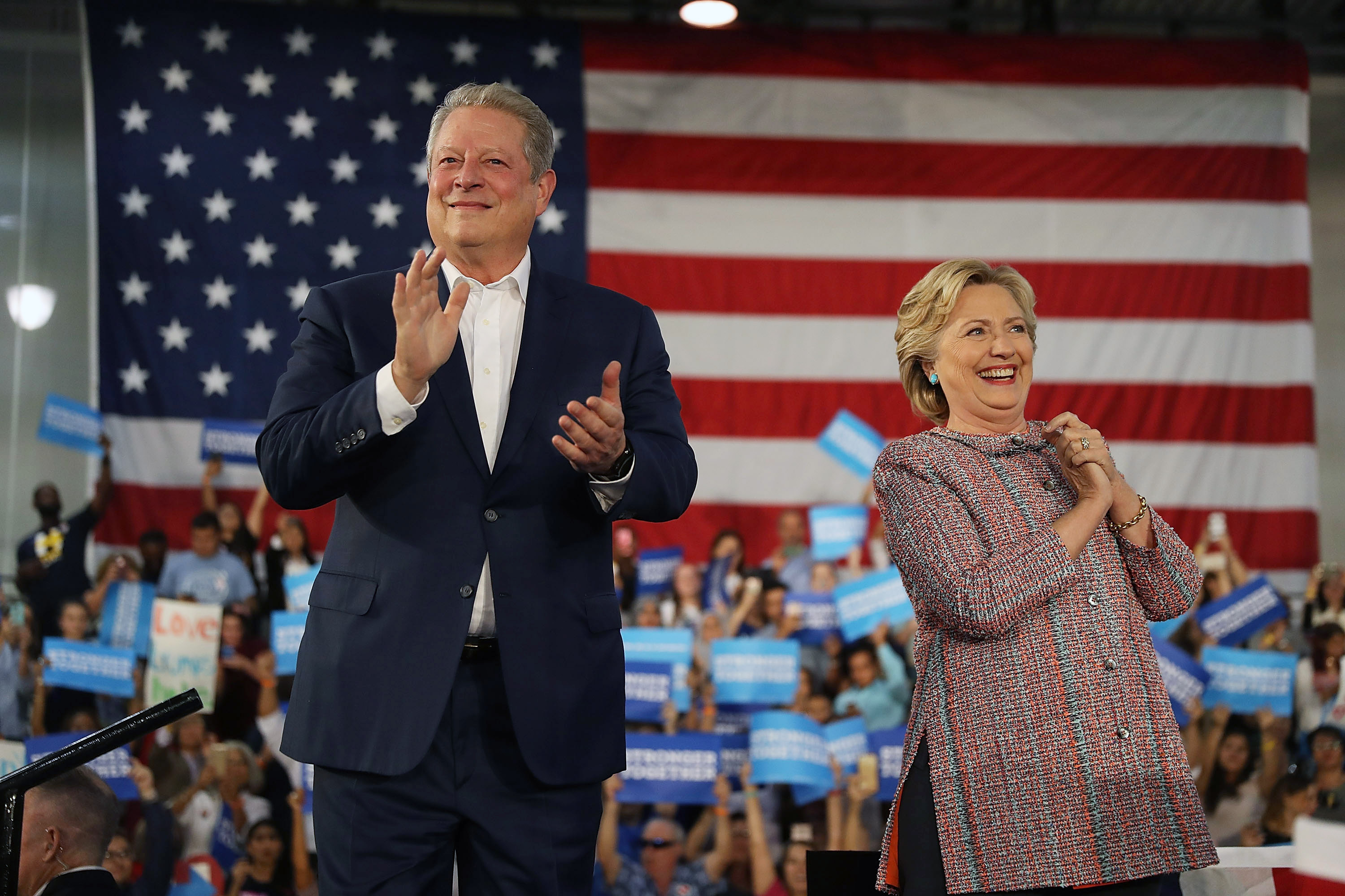 Democratic presidential nominee former Secretary of State Hillary Clinton and former Vice President Al Gore campaign together at the Miami Dade College on Oct. 11. in Miami.