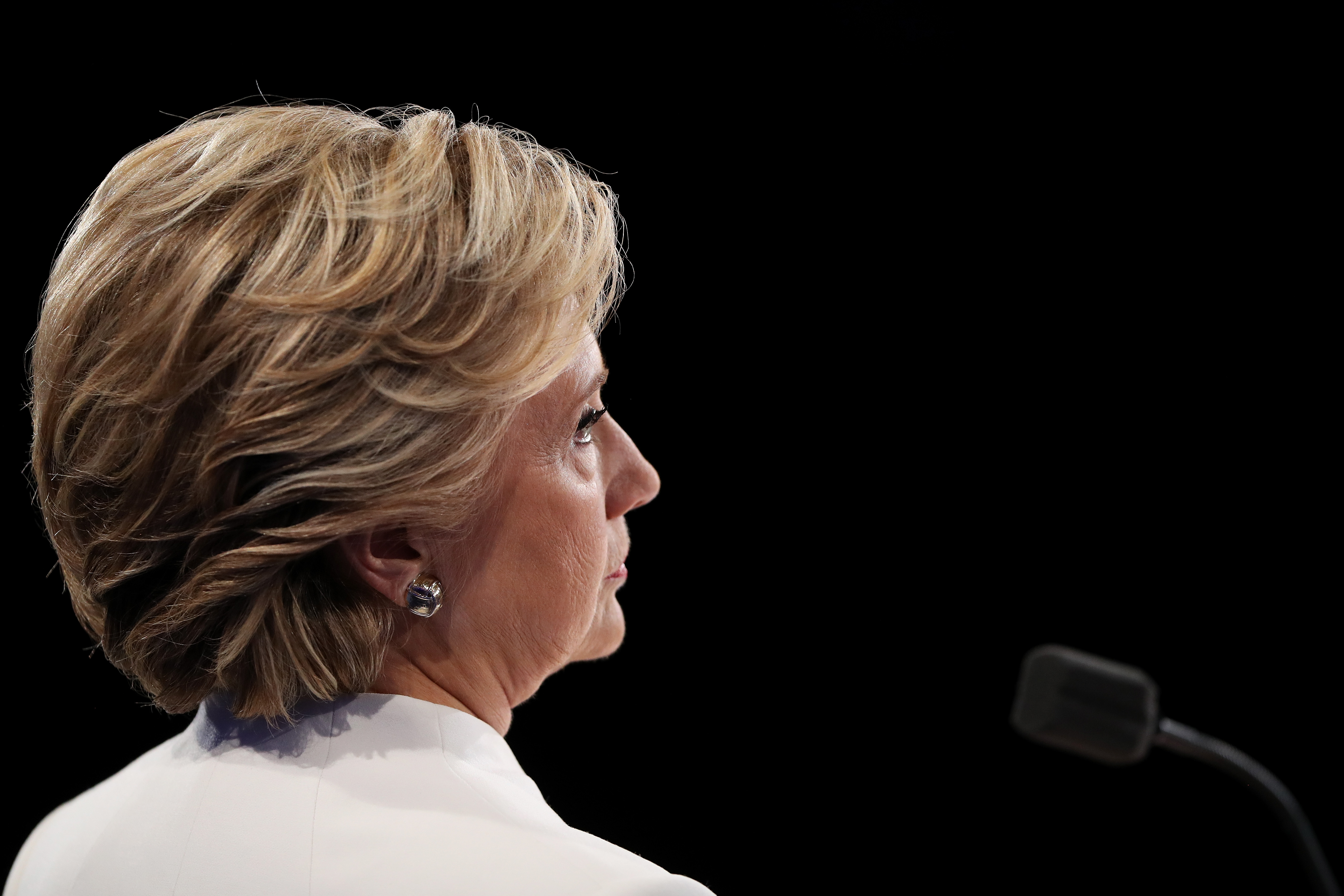 Democratic presidential nominee Hillary Clinton listens to Republican presidential nominee Donald Trump speak during the third U.S. presidential debate on October 19, 2016 in Las Vegas, Nevada.