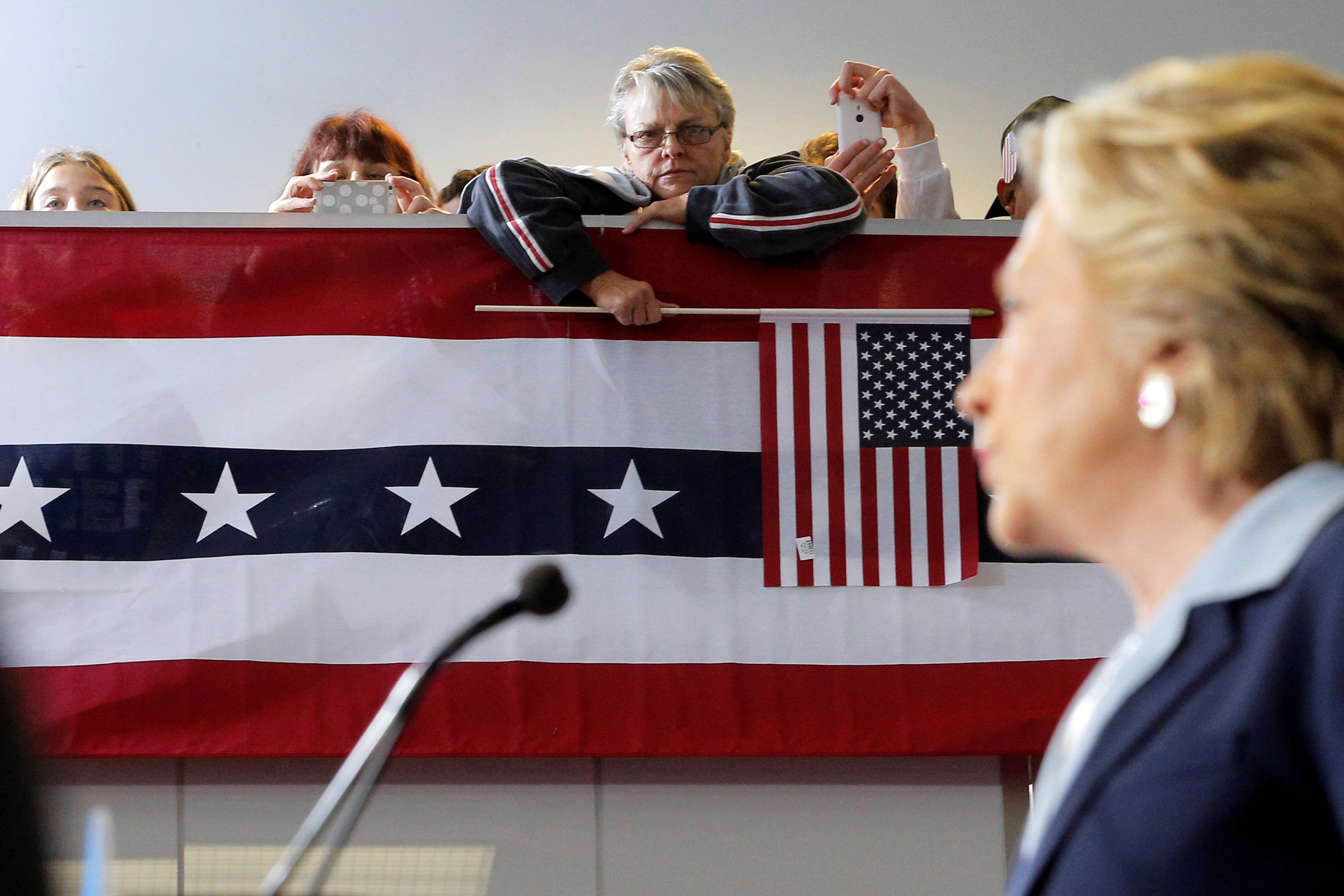 Audience members listen as Democratic presidential nominee Hillary Clinton delivers an economic speech during a campaign stop in Toledo, Ohio, on Oct. 3, 2016.
