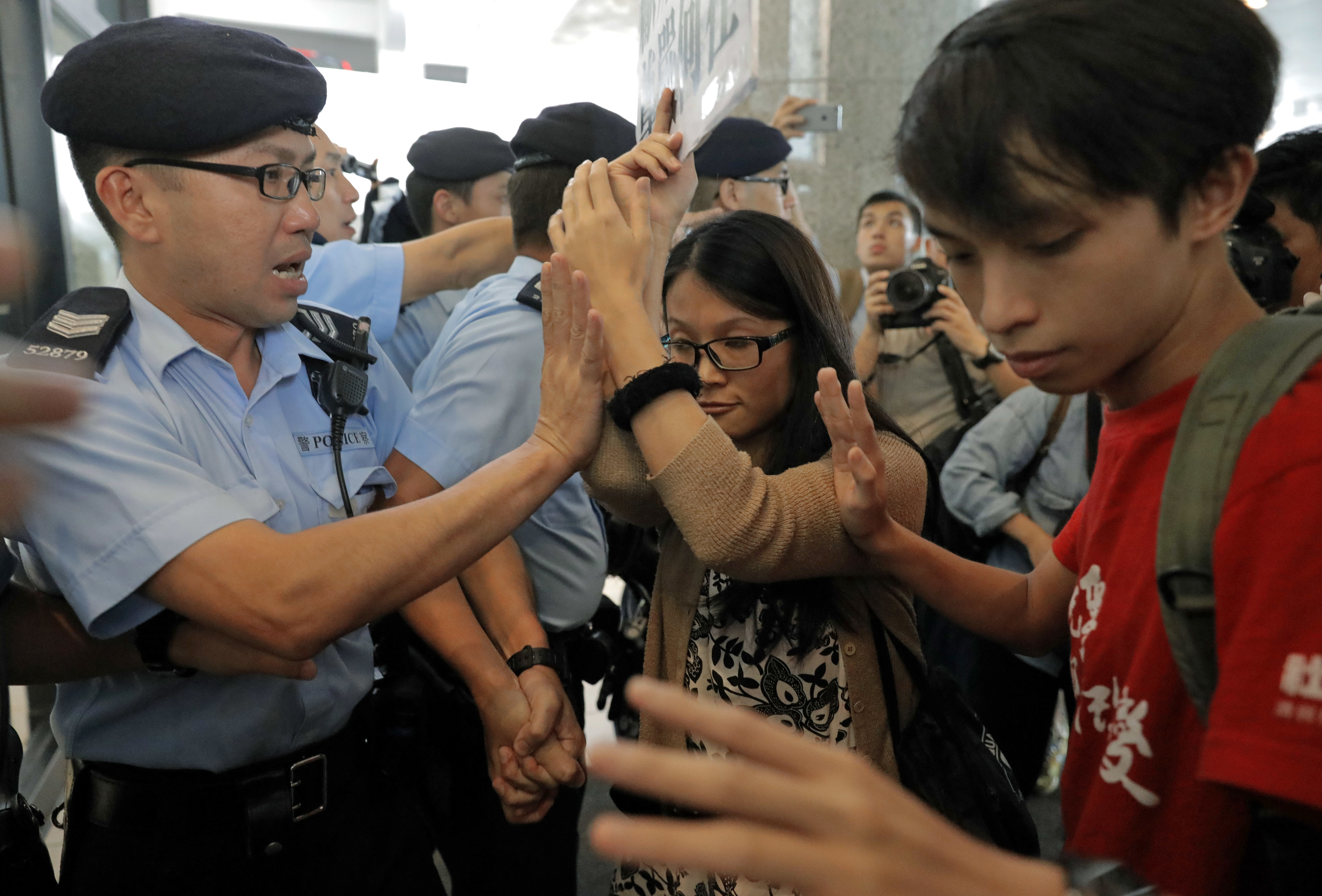 Protesters scuffle with police officers as they protest at the Thai consulate in Hong Kong on Oct. 5, 2016, after Thailand stopped teen pro-democracy activist Joshua Wong from entering the country
