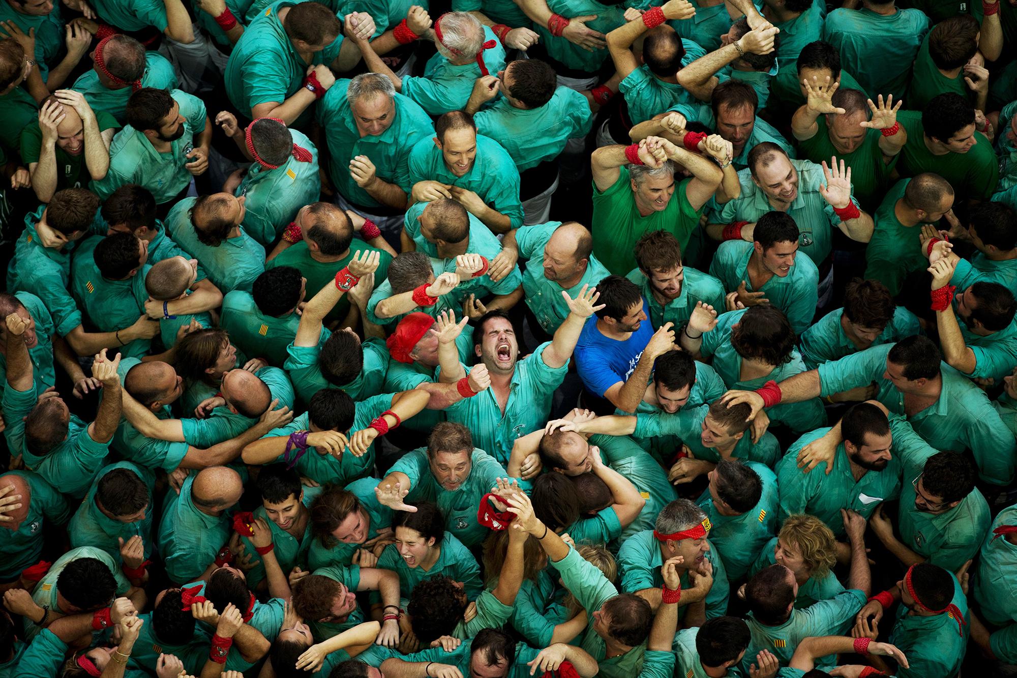 Castellers de Villafranca  react after completing their human tower in Tarragona, Spain, on Oct. 2, 2016.