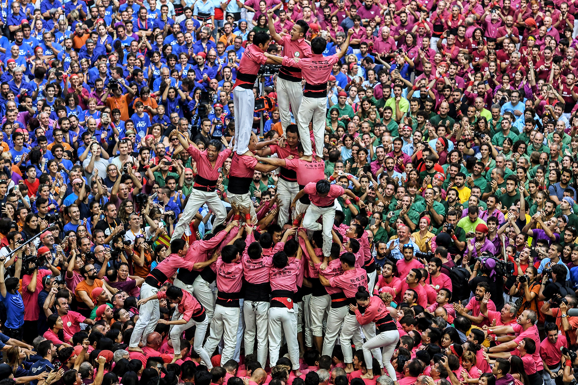 Xiquets de Hanghzou  celebrate after building a human tower in Tarragona, Spain, on Oct. 1, 2016.