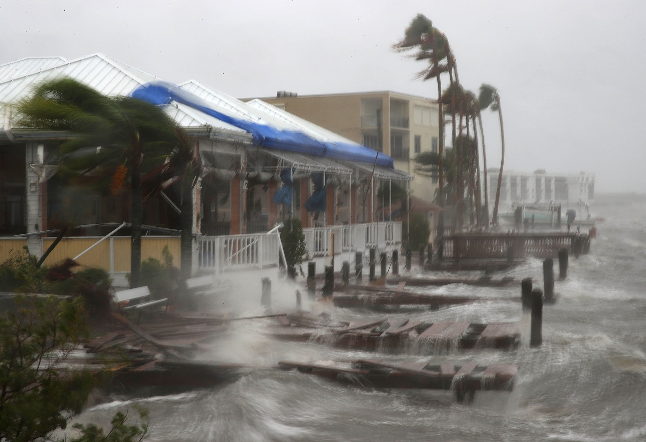 Heavy waves caused by Hurricane Matthew pound the boat docks at the Sunset Bar and Grill on Cocoa Beach, Fla., Oct. 7, 2016.