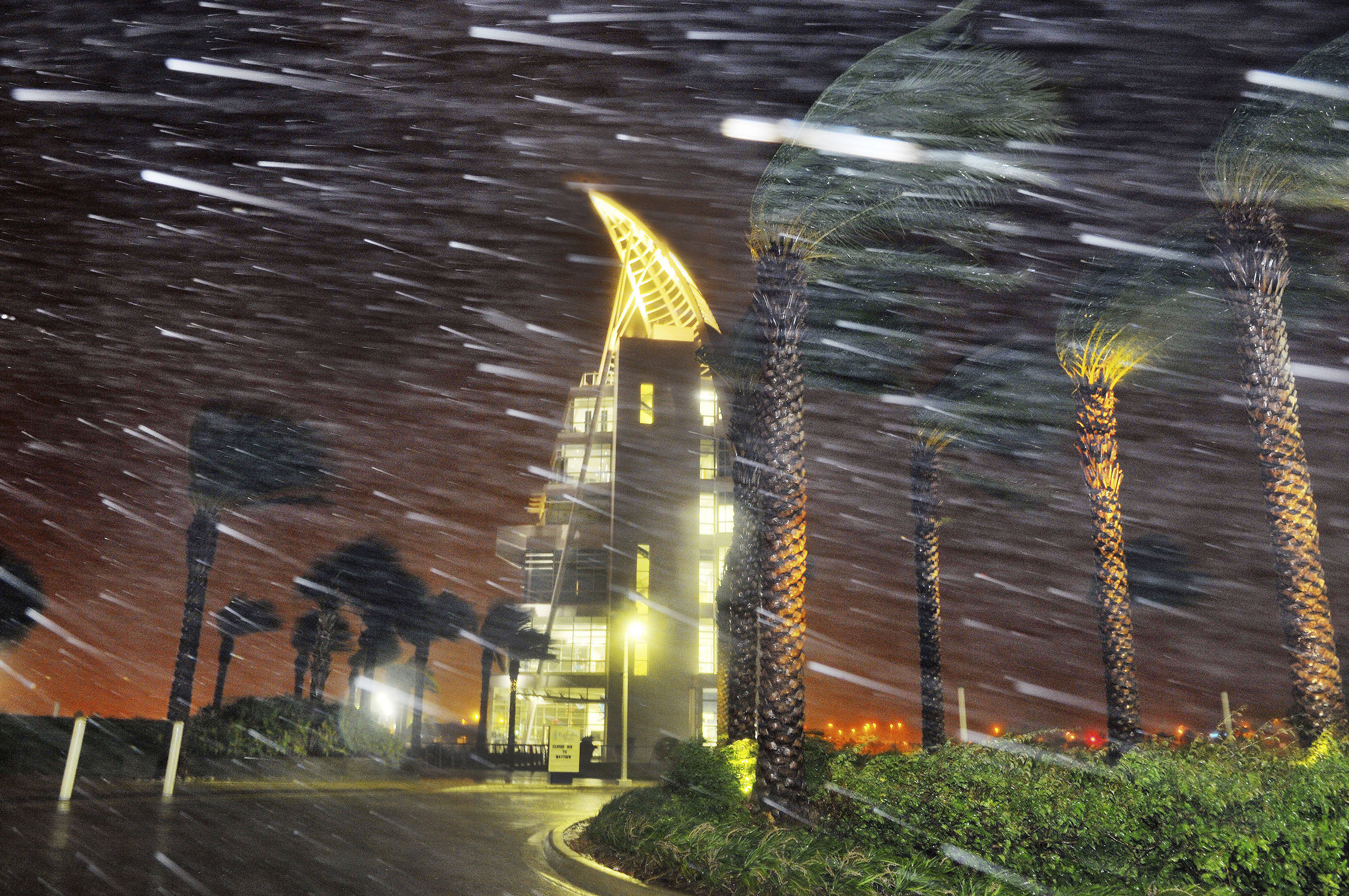 Trees sway from heavy rain and wind from Hurricane Matthew in front of Exploration Tower in Cape Canaveral, Fla., Oct. 7, 2016.