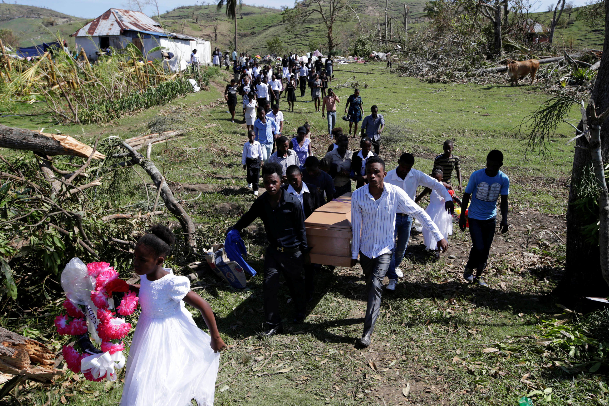 Friends and relatives attend the funeral of Anne Dit Trozitha Zamore, who died during Hurricane Matthew, in Chantal, Haiti, on Oct. 8, 2016.