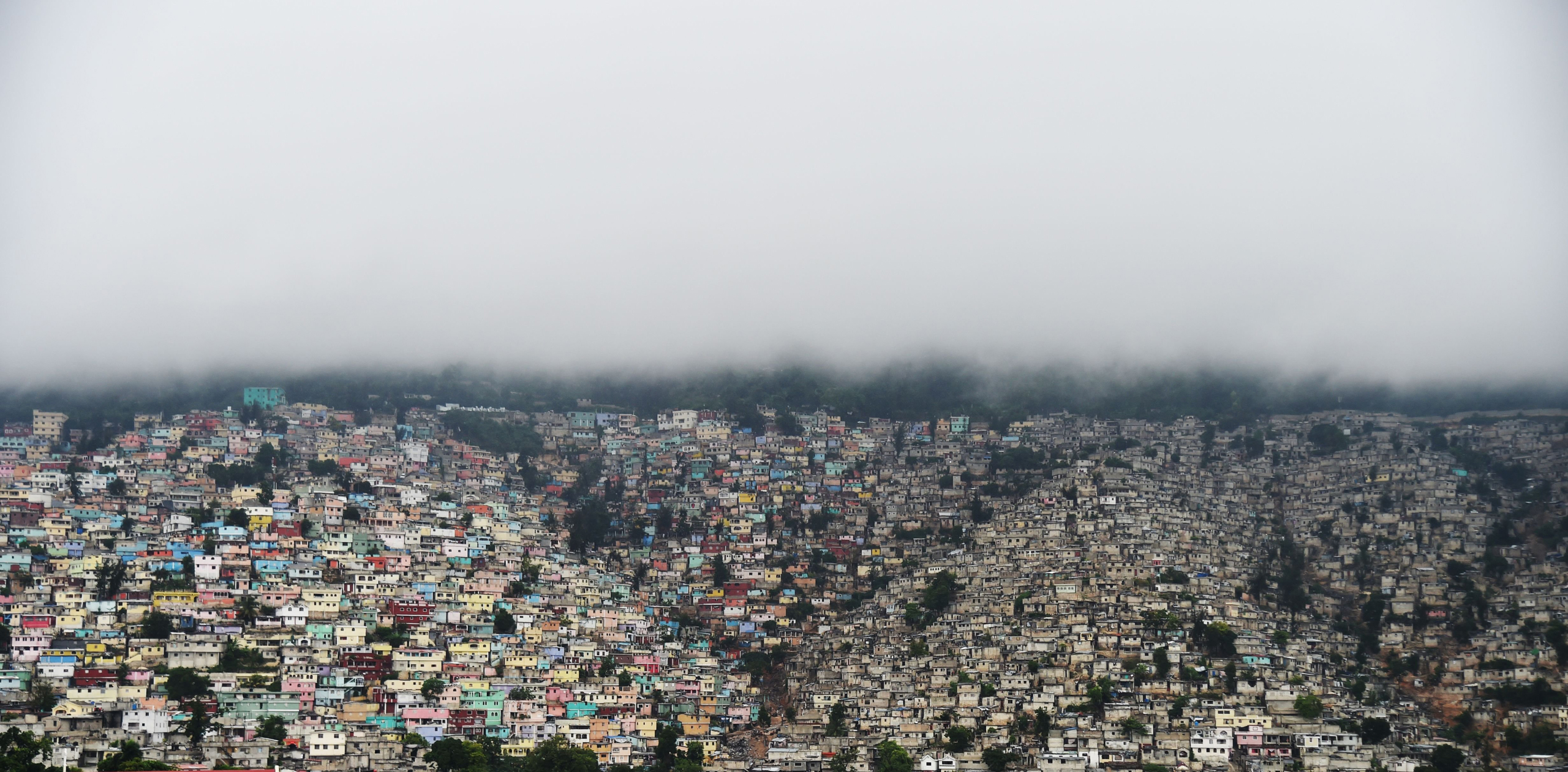 Clouds cover the mountains of Petion Ville in Port-au-Prince, on Oct. 3, 2016.