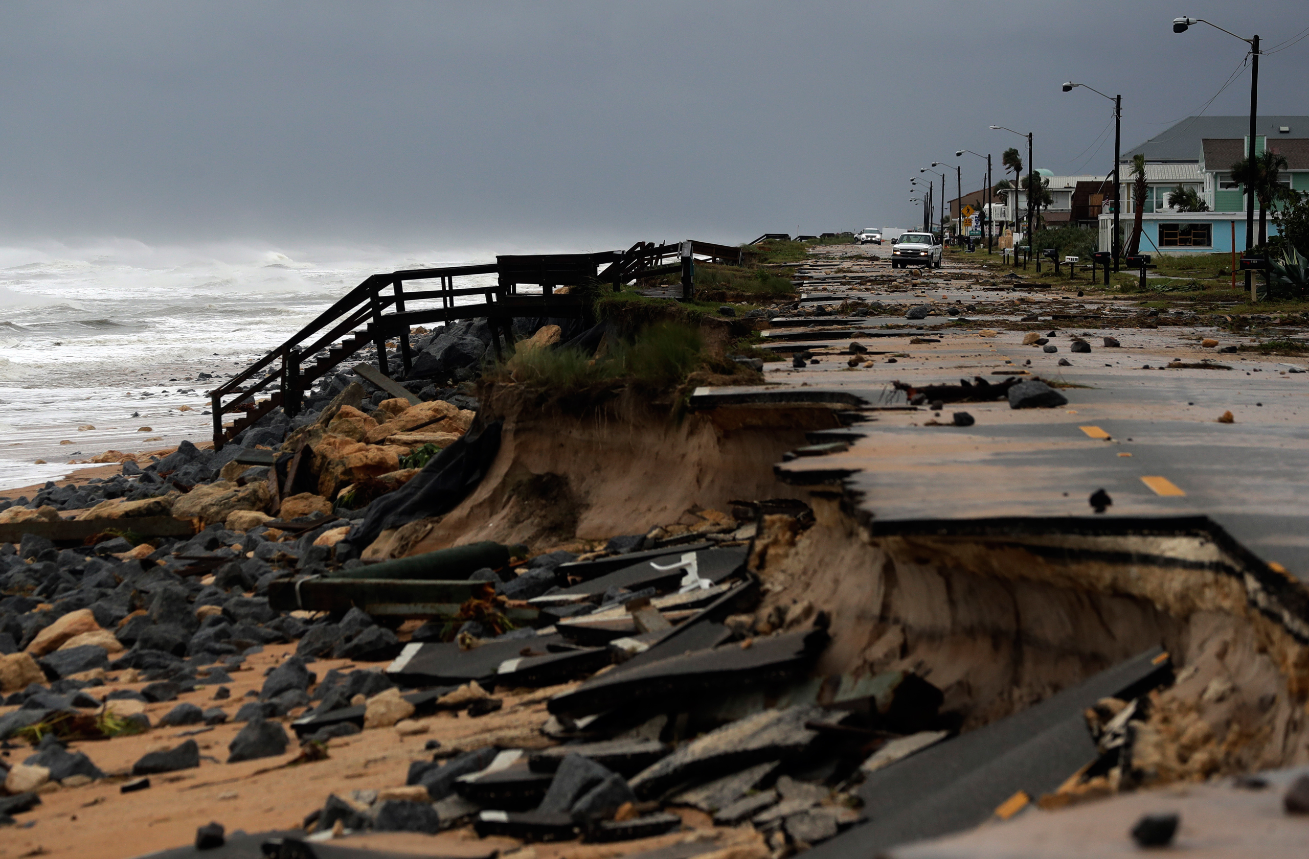 An official vehicle navigates debris on Highway A1A after it was partially washed away by Hurricane Matthew in Flagler Beach, Fla., on Oct. 7, 2016.