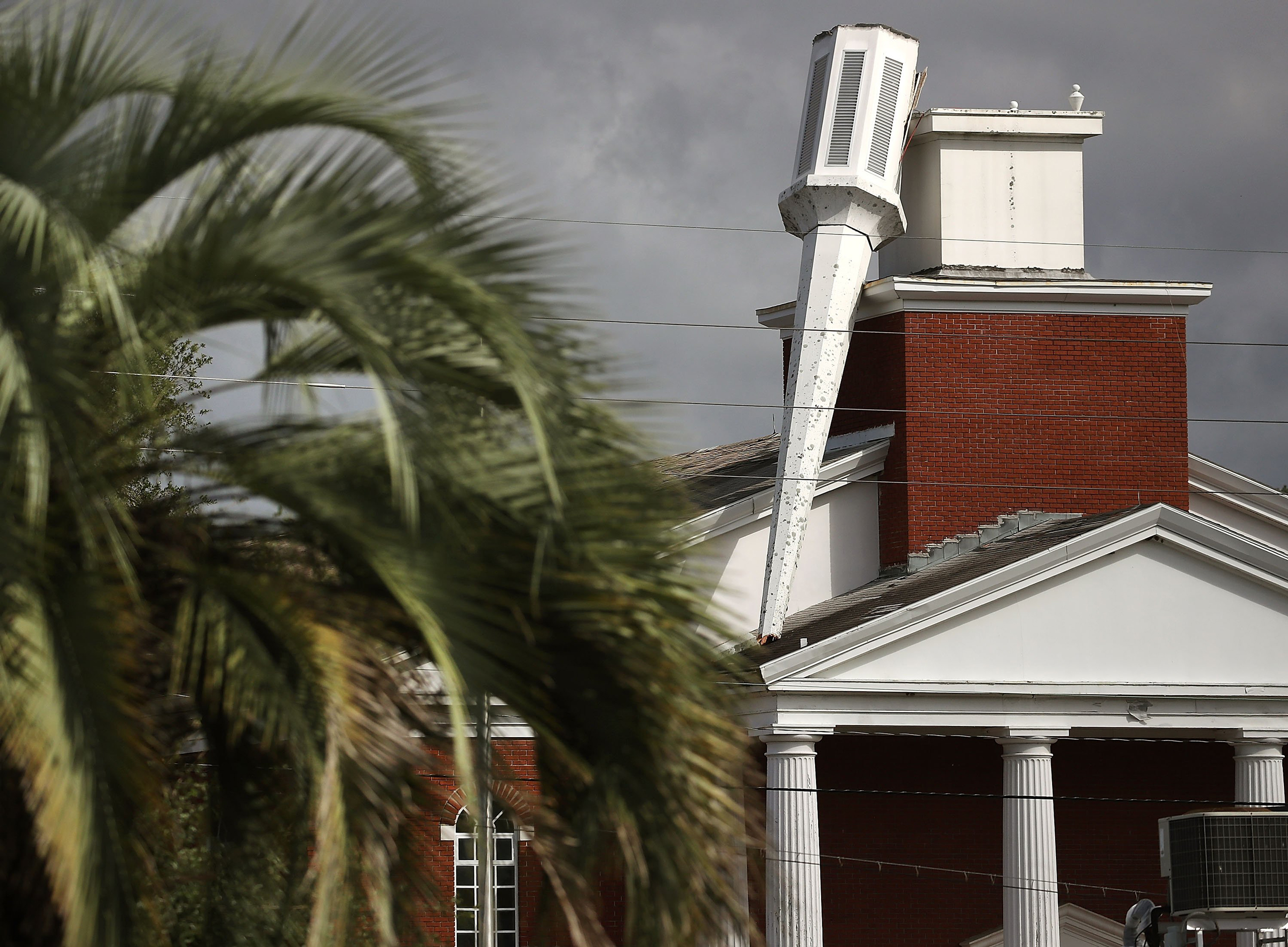 The steeple atop of the Morning Glory Christian Church was toppled over by the strong winds of Hurricane Matthew in Jacksonville, Fla., on Oct. 8, 2016.