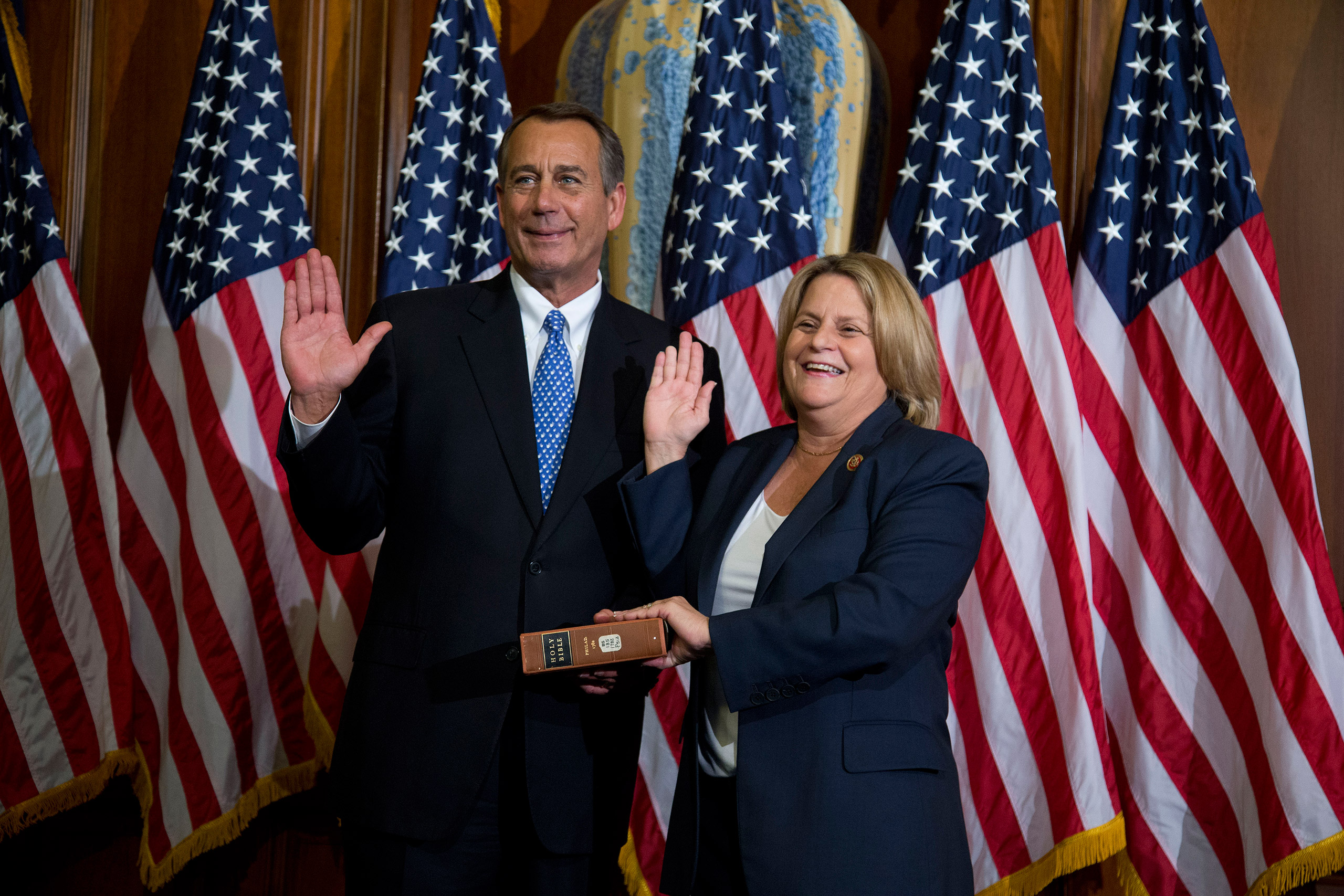 House Speaker John Boehner of Ohio performs a mock swearing in for Rep. Ileana Ros-Lehtinen, R-Fla., Thursday, Jan. 3, 2013, on Capitol Hill in Washington as the 113th Congress began.