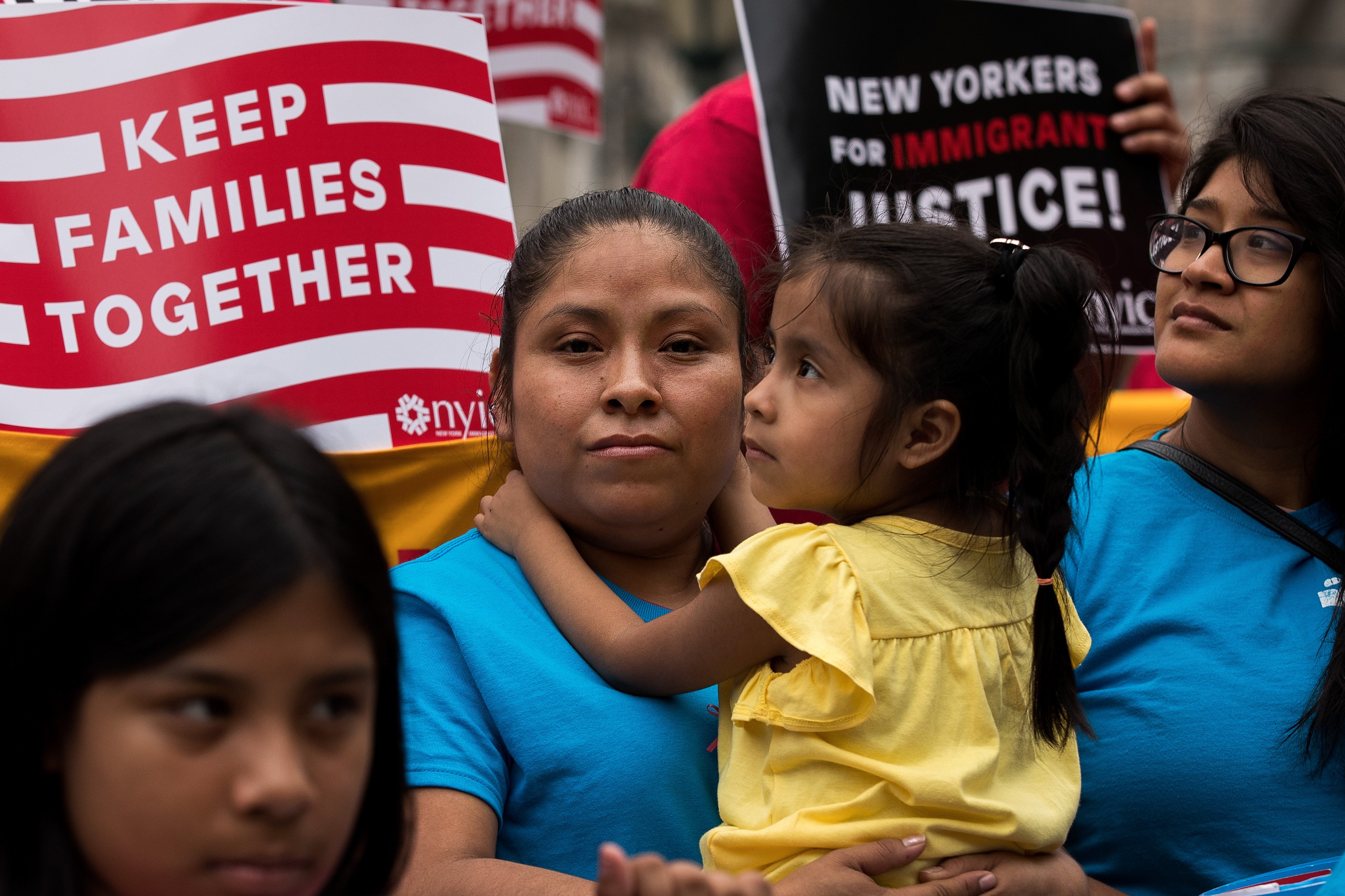 Mexican immigrant Nieves Ojendiz holds her 4-year old daughter Jane as she attends an immigration reform rally in New York City, on June 28, 2016.