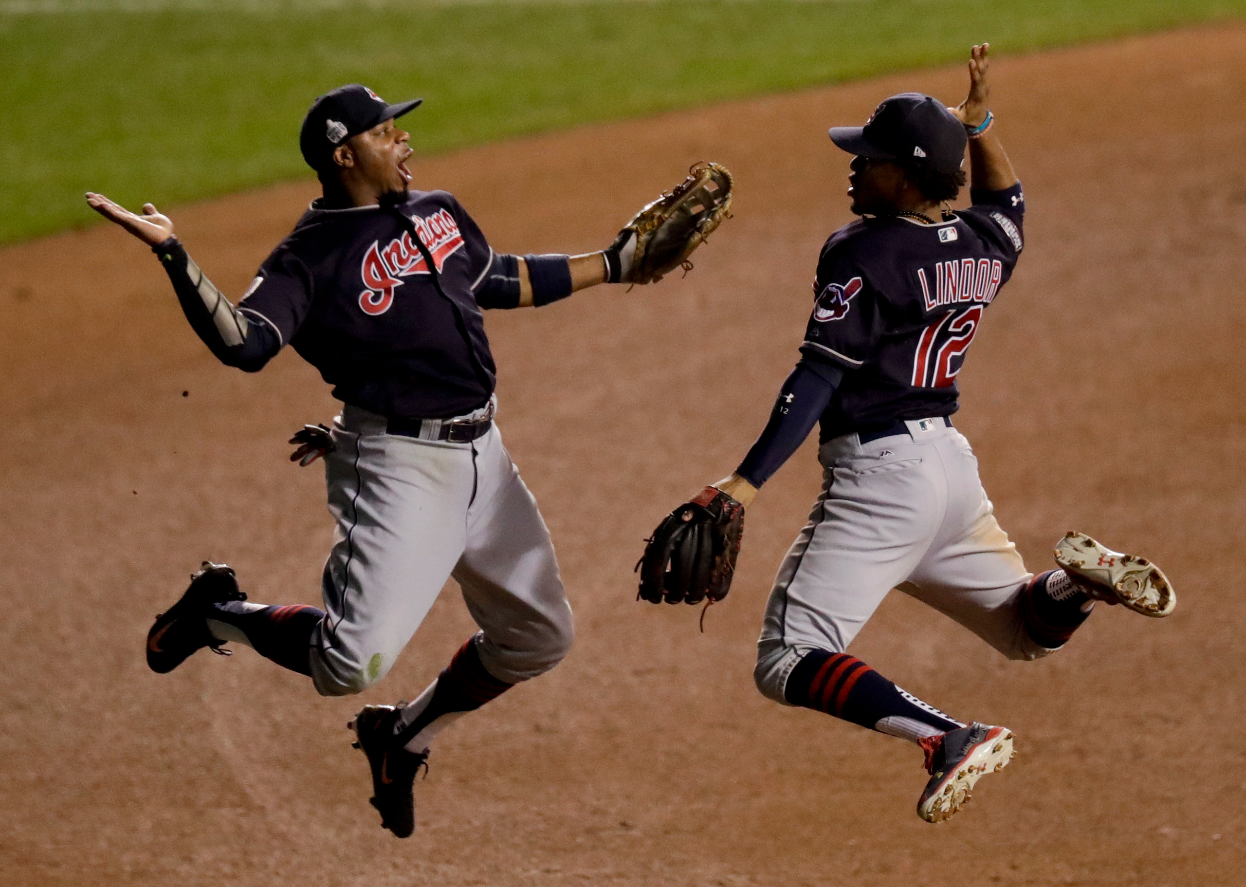 Cleveland Indians left fielder Rajai Davis, left, and shortstop Francisco Lindor celebrate their win after Game 4 of the Major League Baseball World Series against the Chicago Cubs on Oct. 29, 2016, in Chicago.