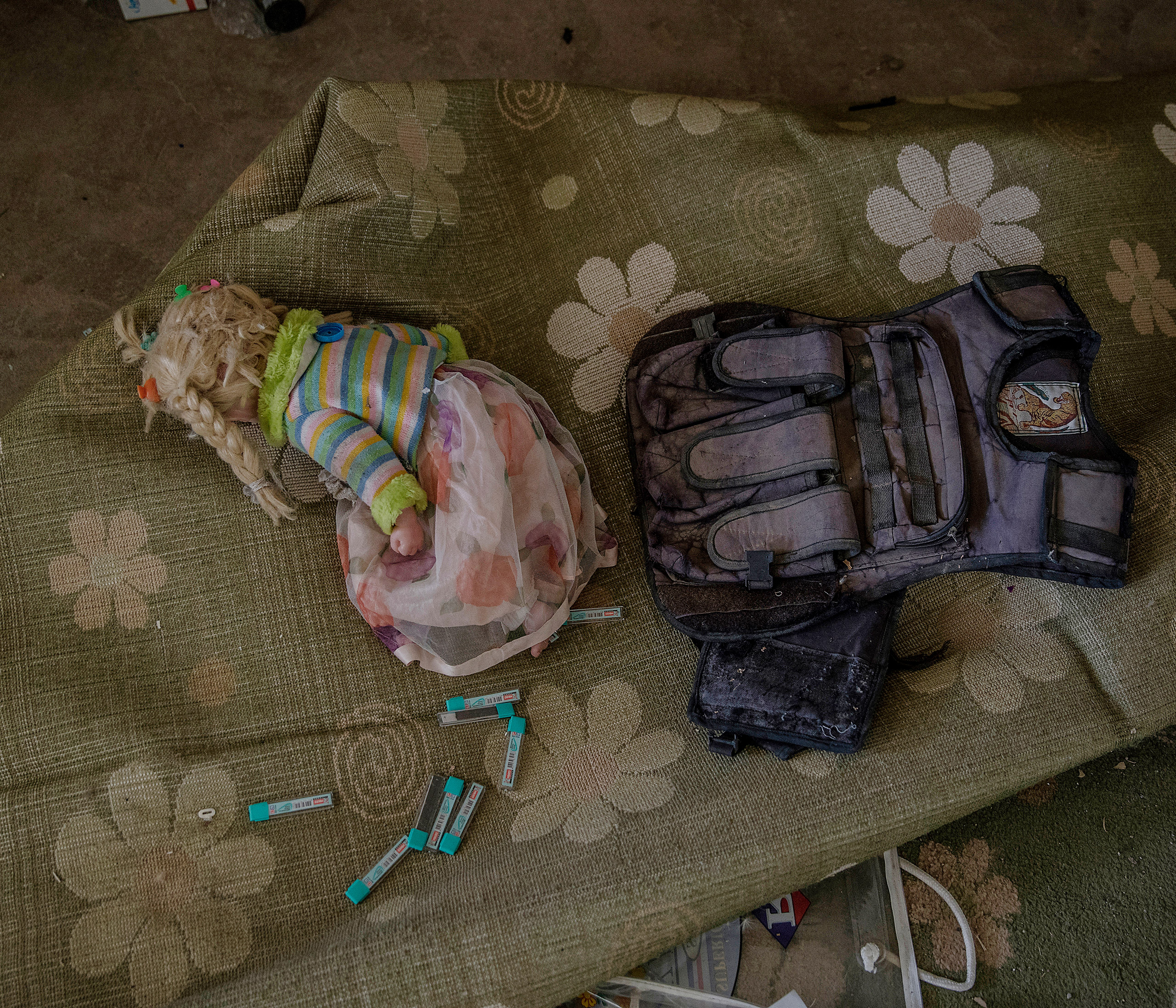 A doll and a fighter's vest found in a house once occupied by ISIS in northern, Iraq, Oct. 2016.