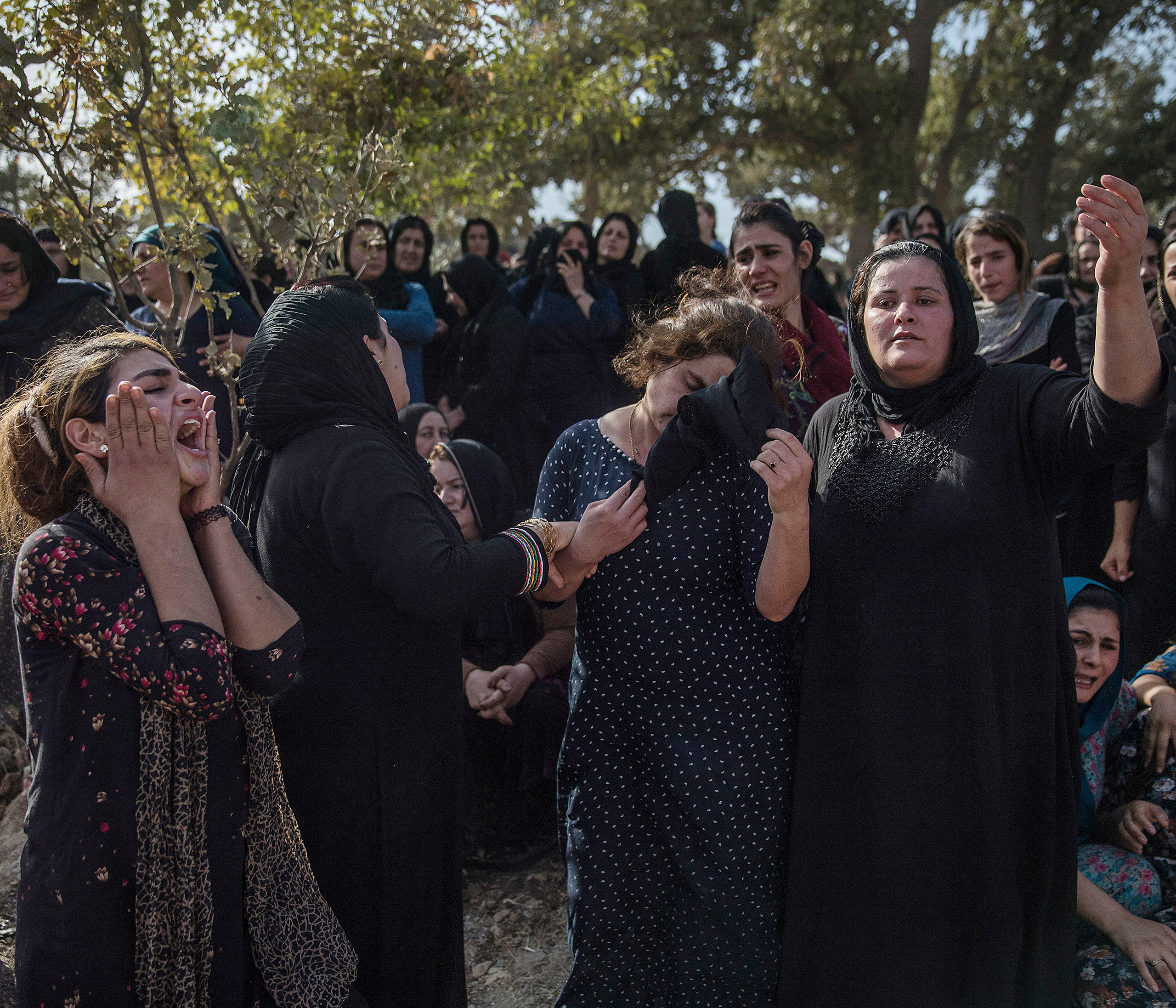 Thousands of people gather at the funeral of five Peshmerga soldiers killed by an IED explosion in their village of Khalifa, Iraq. The village has lost nearly 300 soldiers in the war against ISIS, Oct. 2016.