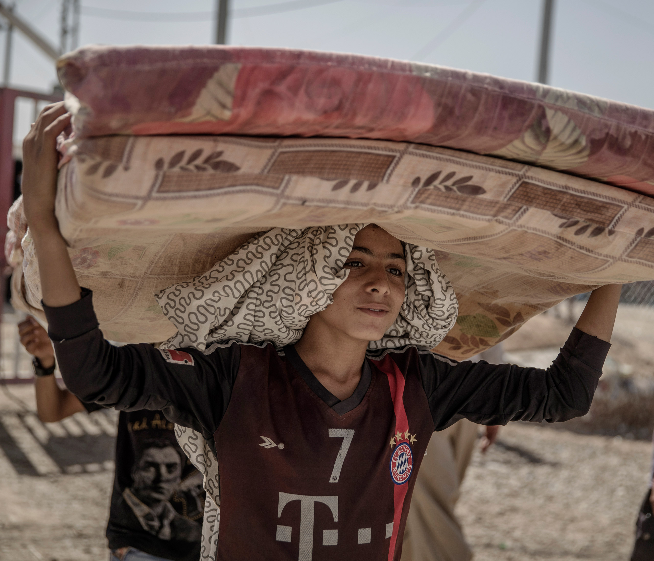A boy at the Debaga refugee camp, outside Mosul in northern Iraq, Oct. 2016.  Displaced people (IDPs) are fleeing to this camp, which is already overcrowded, with many more refugees expected as  the offensive against ISIS continues.