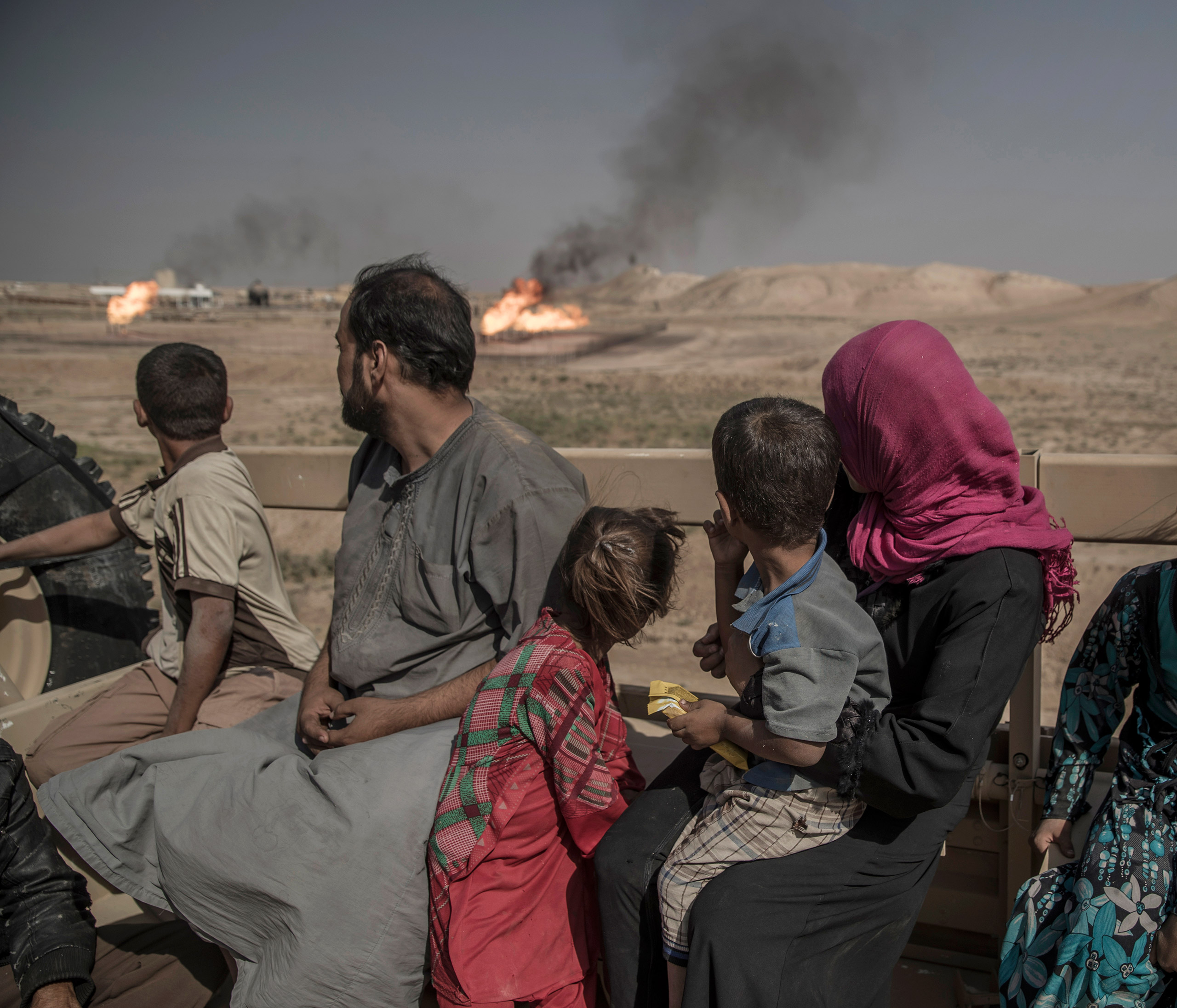 In the mountains outside Mosul, a group of 12, including men, women and children who escaped from an IS-controlled village, have sought refuge with the Kurdish Peshmerga forces on the frontline in Kurdistan, Iraq, Sept. 2016