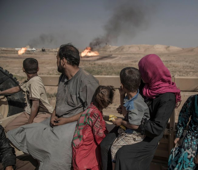 In the mountains outside Mosul, a group of twelve, including men, women and children who escaped from an IS-controlled village, have sought refuge with the Kurdish Peshmerga forces on the frontline in Kurdistan, Iraq, Sept. 2016