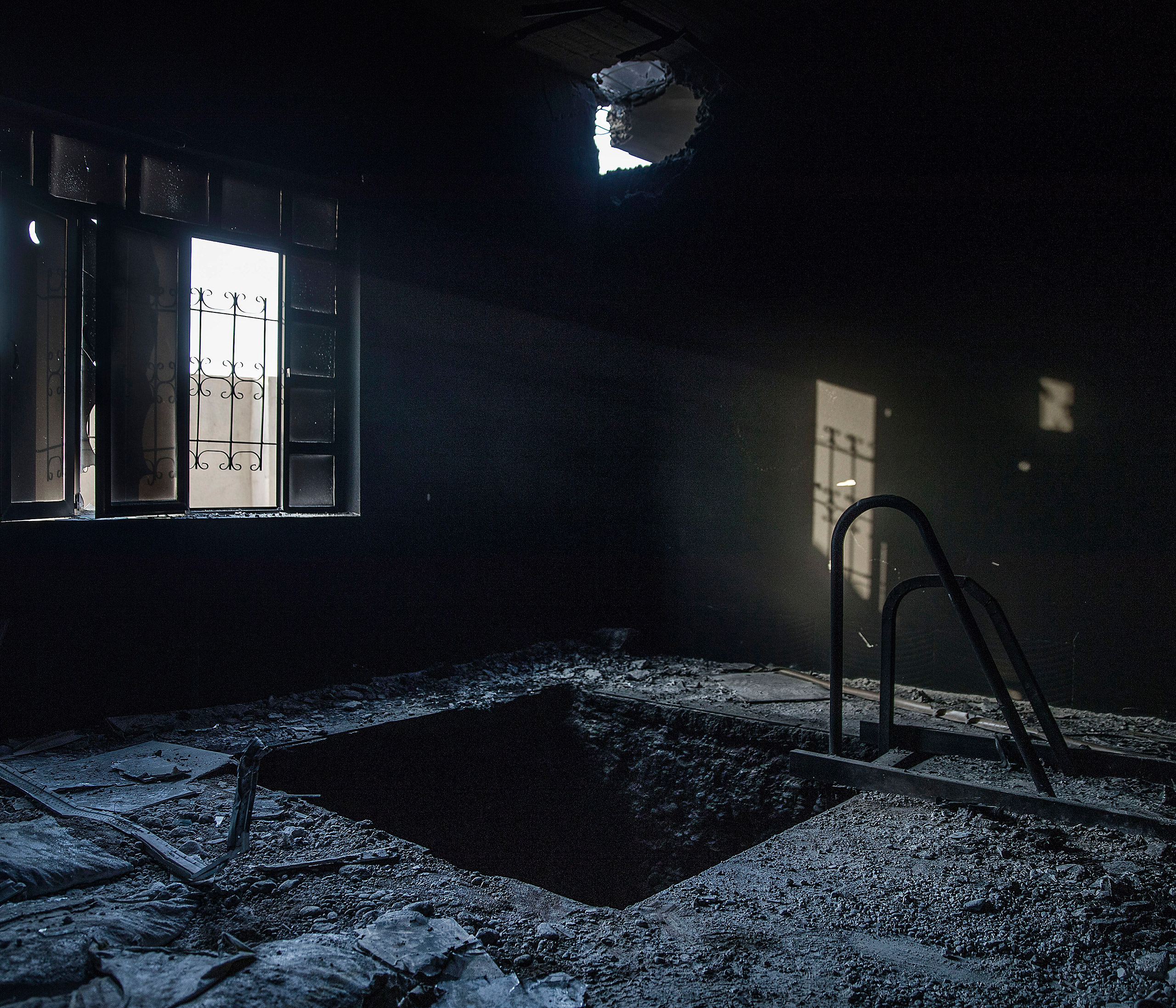 A tunnel inside an abandoned house in the outskirts of Mosul, Iraq, recaptured from the Islamic State (ISIS) jihadists by Kurdish Peshmerga and Iraqi forces, Oct. 2016.