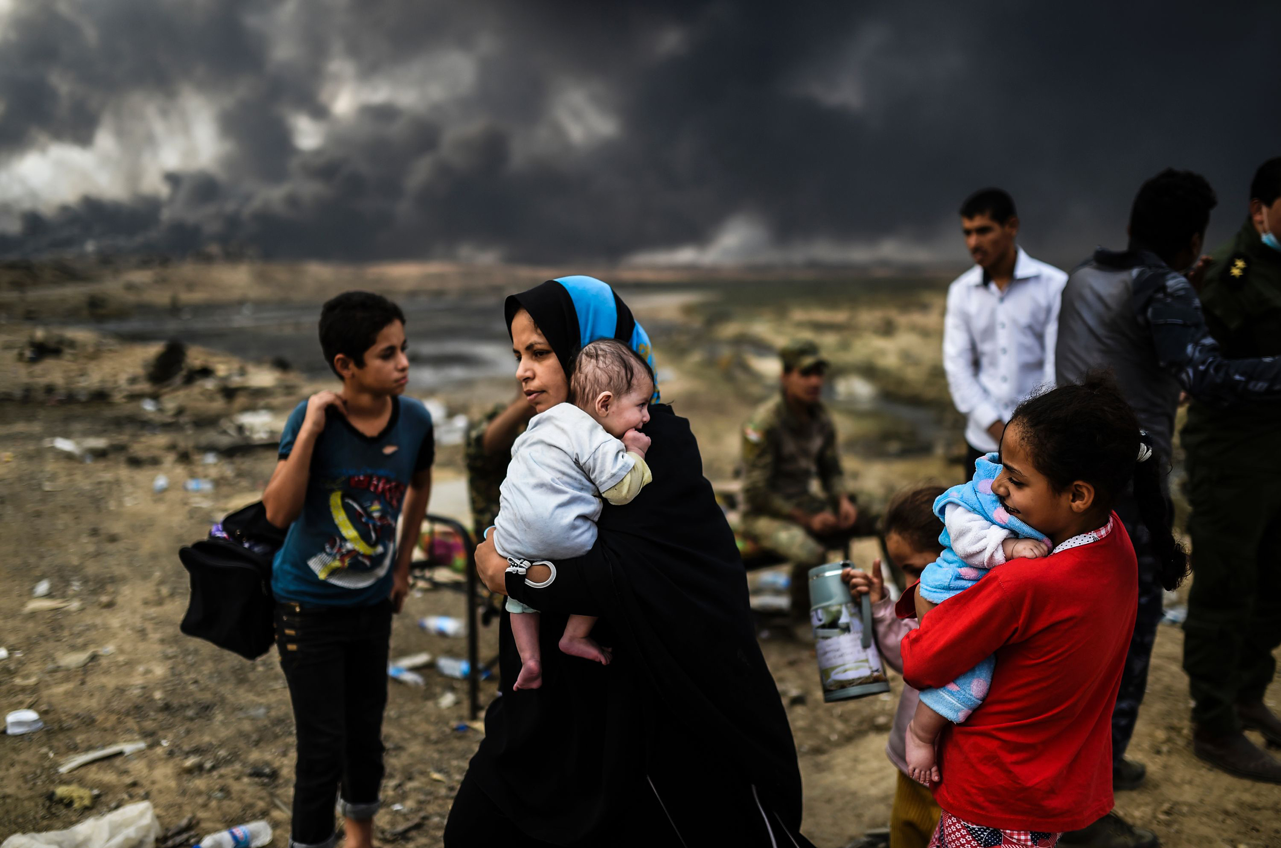 Iraqis displaced by the ongoing operation to retake the city of Mosul, held by ISIS since 2014, gather near Qayyarah on Oct. 24, 2016.