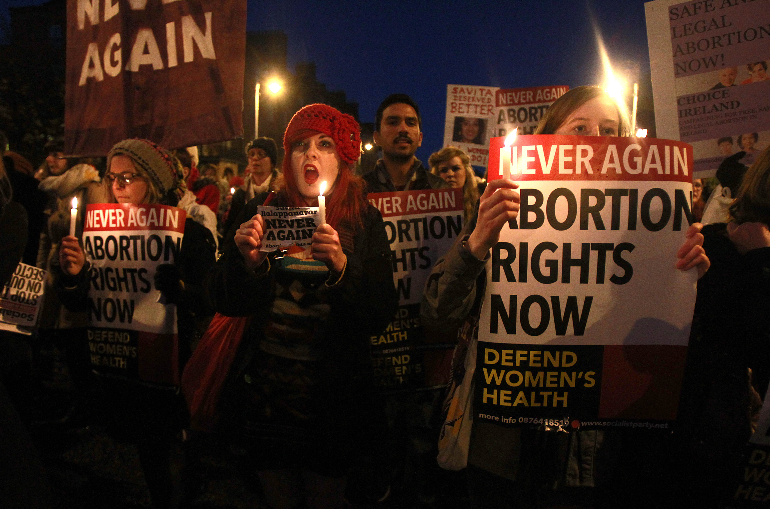 Demonstrators hold placards and candles in memory of Savita Halappanavar, whose doctors allegedly refused to perform an abortion because it was against the laws of the Catholic country, in Dublin on Nov. 17, 2012. The Indian woman, who was 17 weeks pregnant, repeatedly asked the hospital to terminate her pregnancy because she had severe back pain and was miscarrying, her family said.