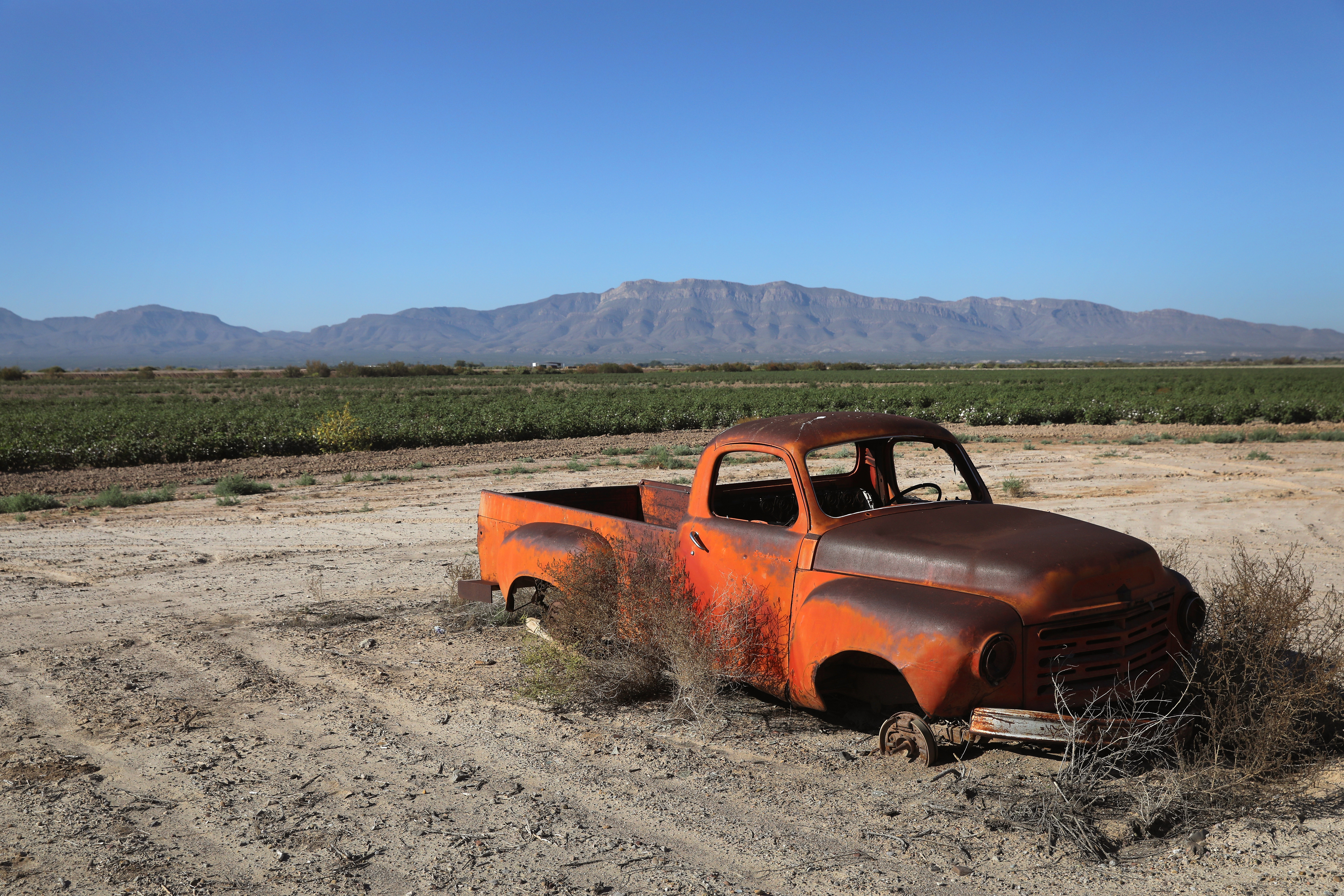 A Studebaker sits outside a cotton field near the U.S.-Mexico border on Oct. 14, 2016 near Fort Hancock, Texas.