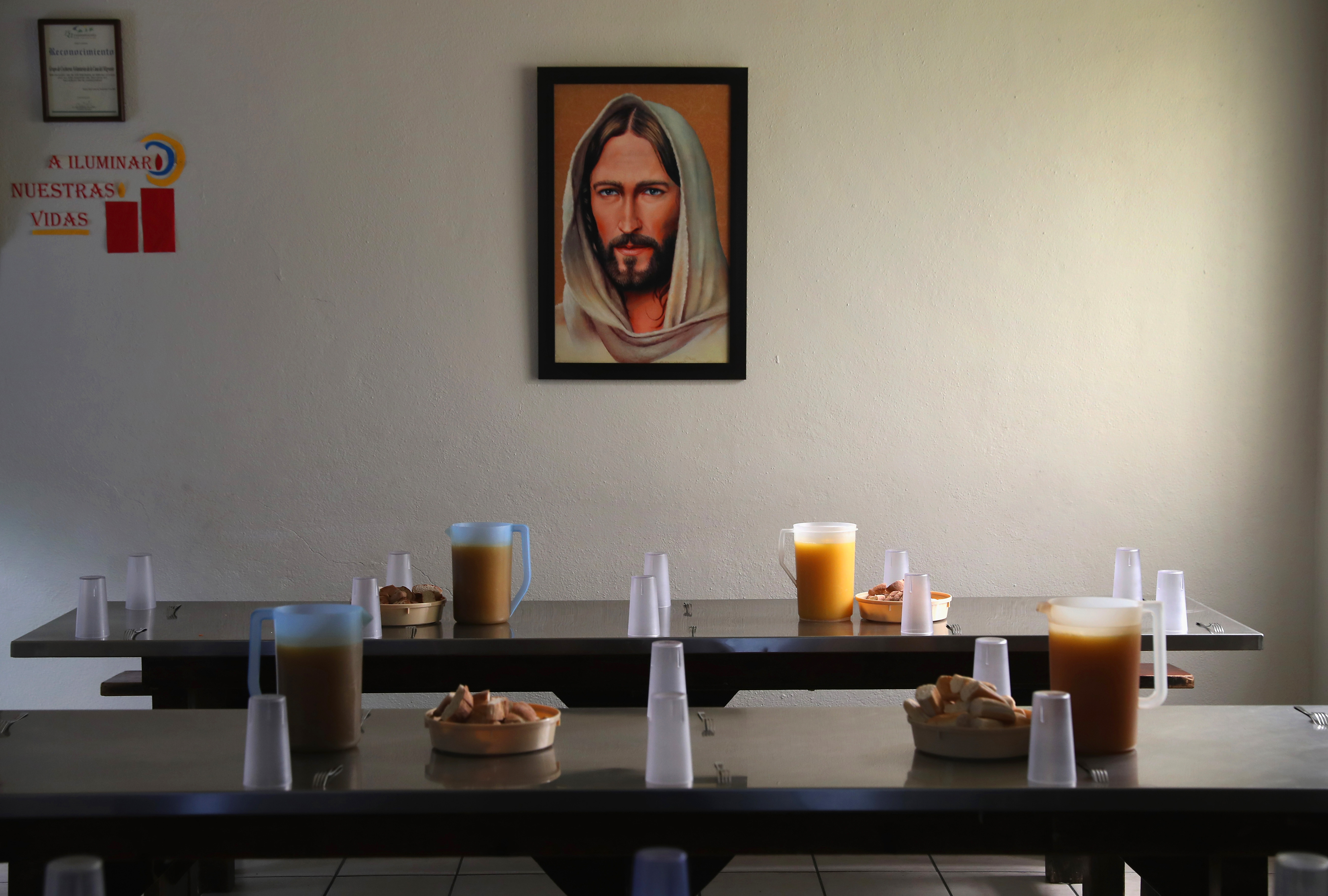 Dinner tables await immigrants, many of them deportees from the United States, at the Casa del Migrante Sept. 23, 2016 in Tijuana, Mexico. The shelter, run by Catholic priests, is part of the Coalicion Pro Defensa, which aids immigrants and asylum applicants seeking entry into the United States. The coalition of immigrant advocates has helped thousands of migrants on their journey north and many more after being being deported from the United States.