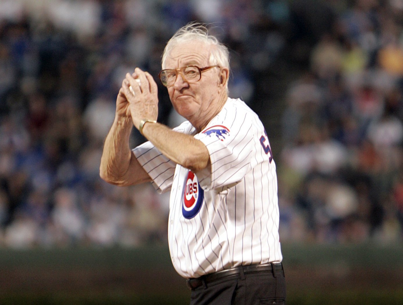 John Paul Stevens winds up to throw out the first pitch before the start of the Chicago Cubs game with the Cincinnati Reds, in Chicago, on Sept. 14, 2005.