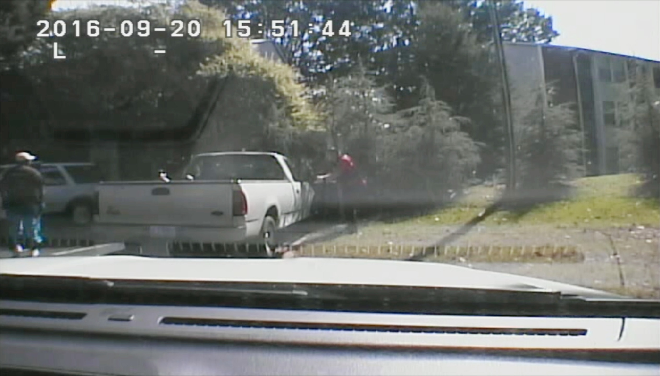 This image made from video provided by the Charlotte-Mecklenburg Police Department on Sept. 24, 2016 shows Keith Scott, left, moments before he was fatally shot by police in Charlotte, N.C., on Sept. 20, 2016.