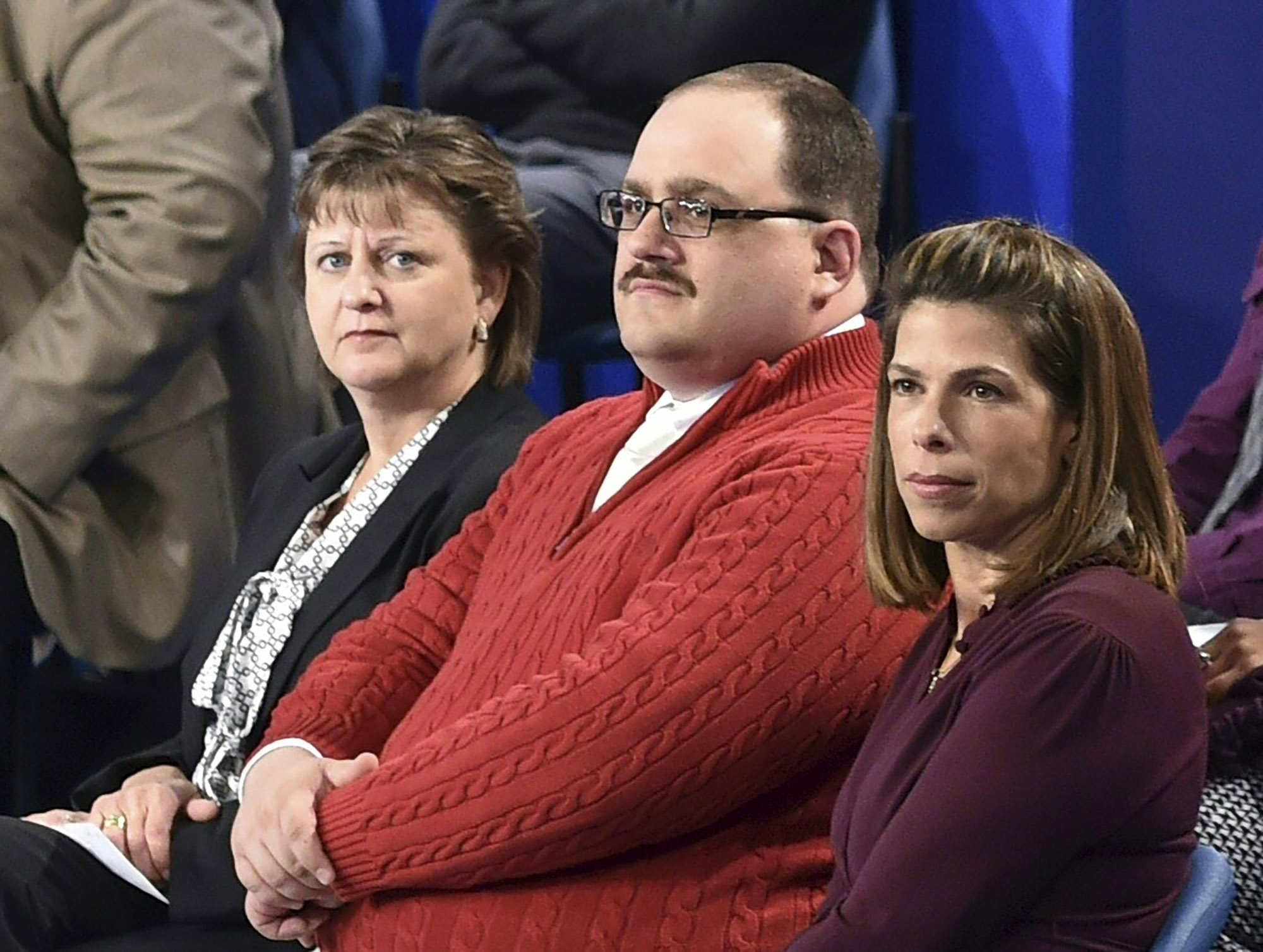 Ken Bone (C) listens to US Democratic nominee Hillary Clinton and Republican nominee Donald Trump during the second presidential debate at Washington University in St. Louis on Oct. 9, 2016.