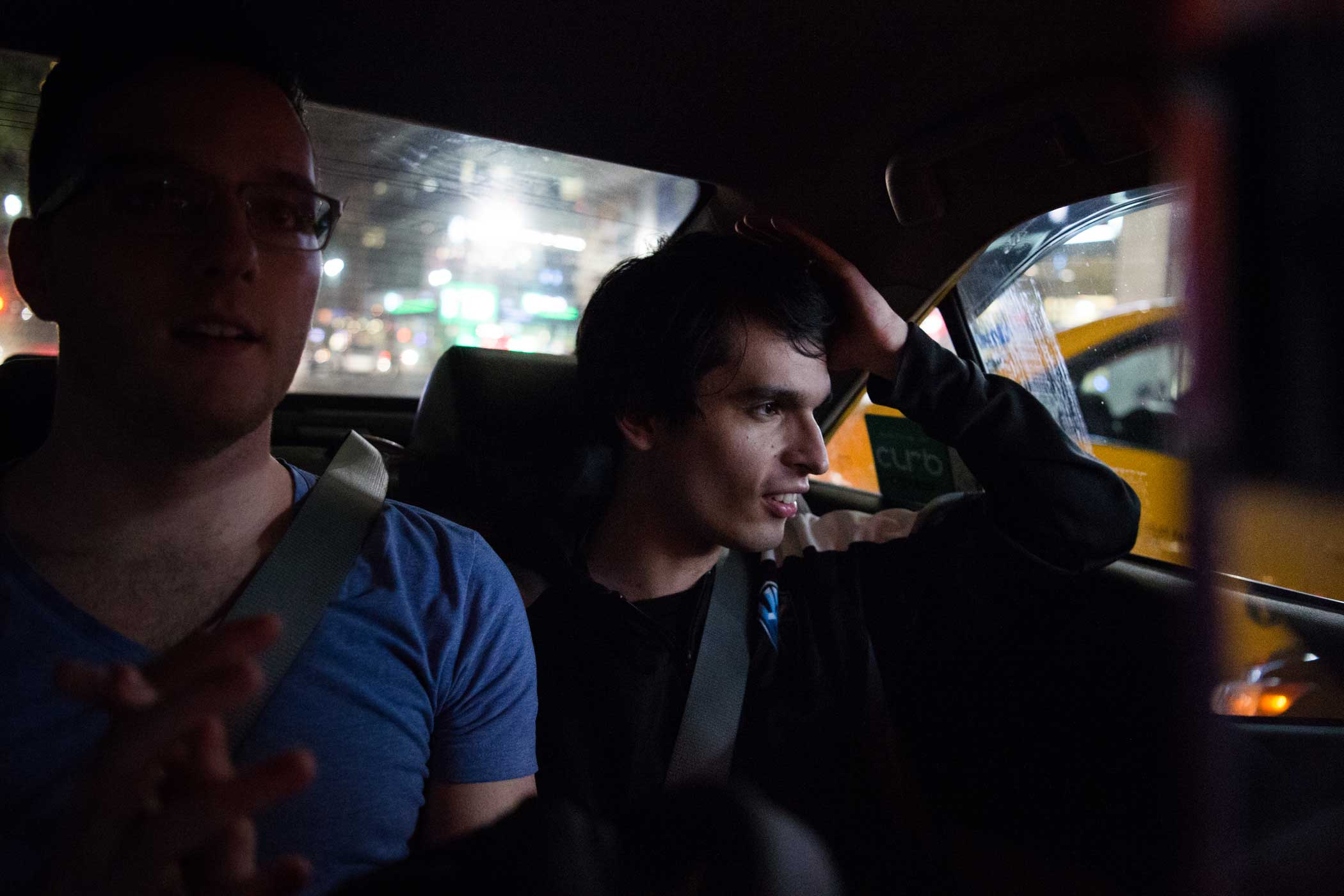 Michael  Veteran  Archer, head analyst for H2k, watches passing traffic as he and other teammates take a cab from Madison Square Garden to a late team dinner at Benihana.