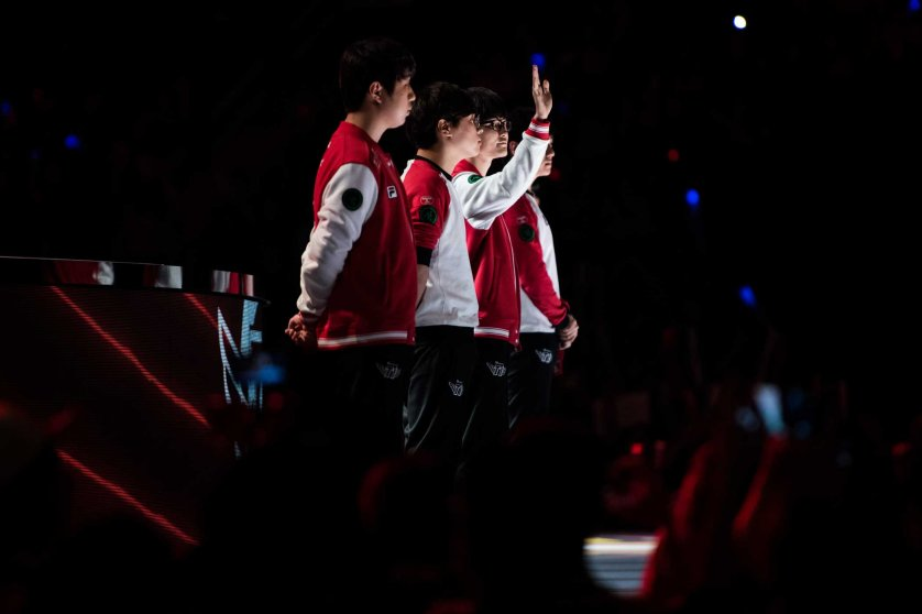 "Lee ""Faker"" Sang-hyeok, second from right, likely the greatest player in the history of League of Legends, waves to the crowd ahead of his team, SK Telecom T1's, semifinal matchup against Korean rivals ROX Tigers. Comparisons have been made by professional journalists inside and outside eSports between Faker and Michael Jordan. Mark Kauzlarich for TIME"