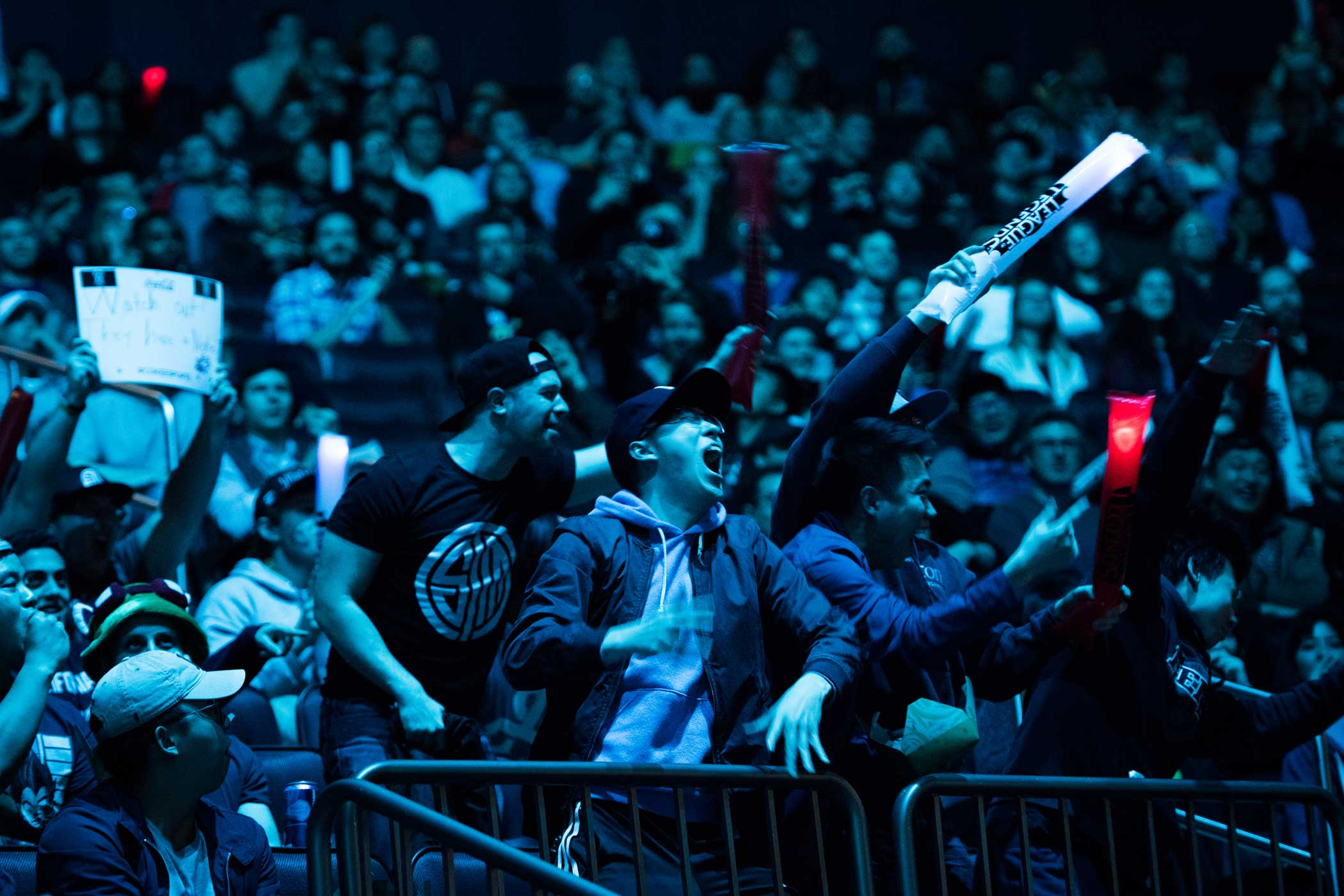 Fans of H2k cheer for the team after they take a surprise first kill in the first game of their best of five match.