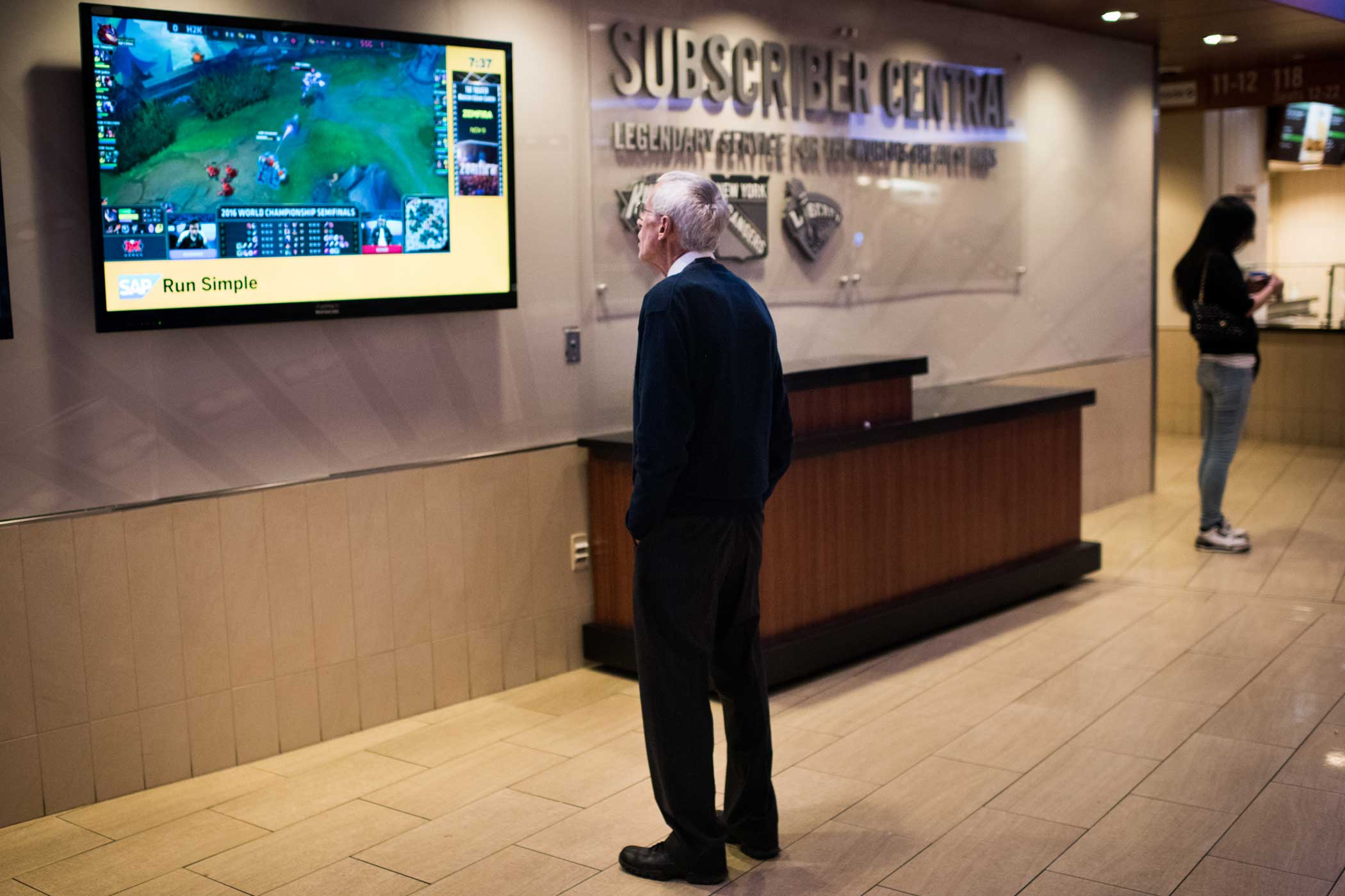A member of the Madison Square Garden staff watches the game on a screen in the concourse.