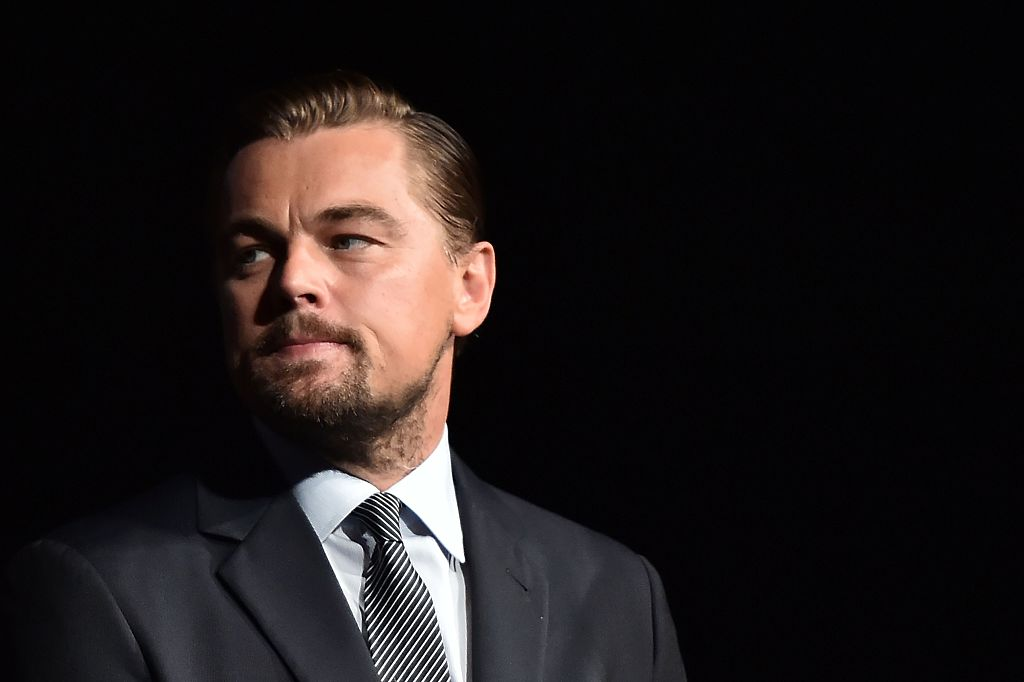 Leonardo DiCaprio looks on prior to speaking on stage during the Paris premiere of the documentary film  Before the Flood  on Oct. 17, 2016 at the Theatre du Chatelet in Paris.