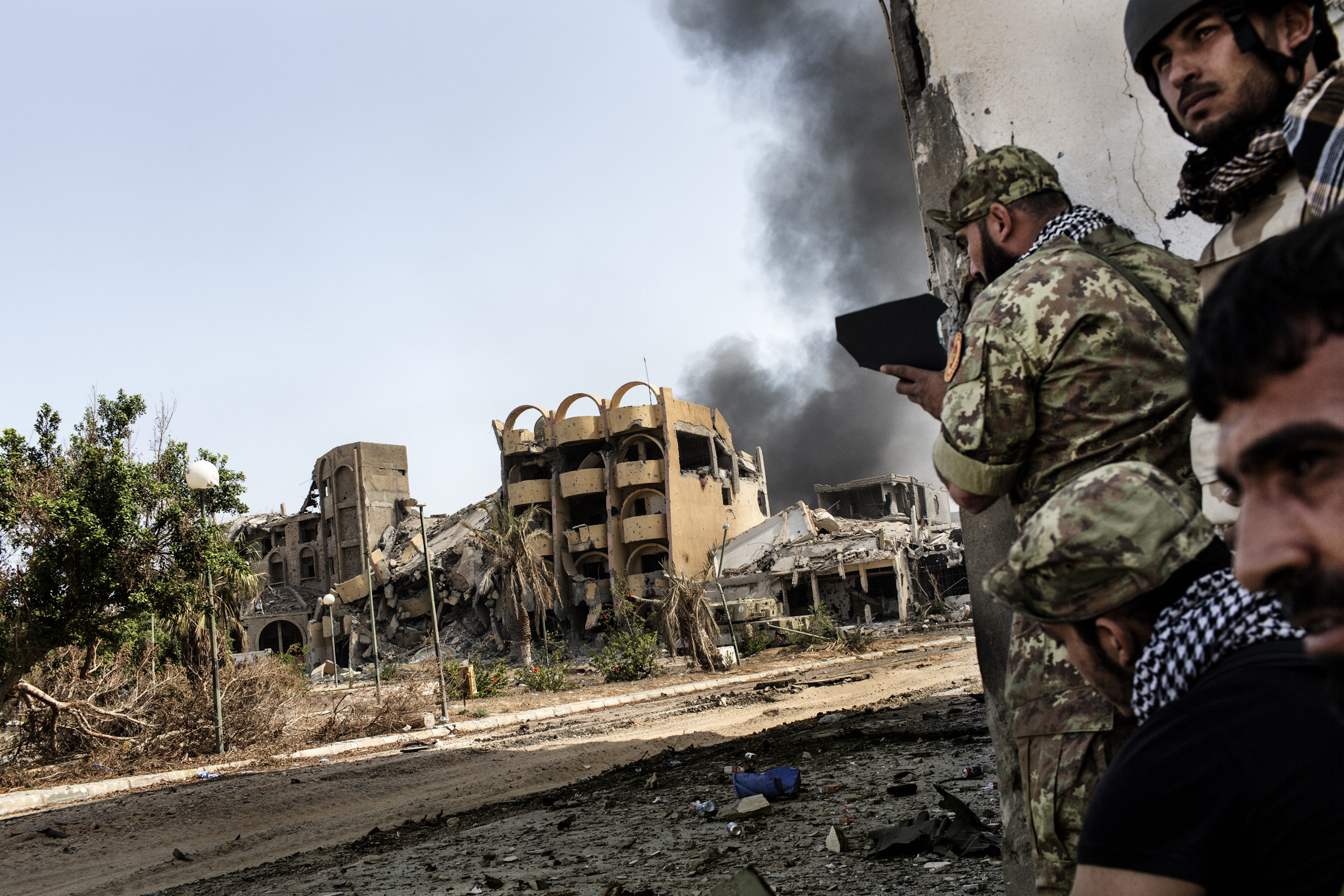 Libyan forces affiliated with the Tripoli government use a mirror to spot ISIS positions in District 3, the last stronghold of ISIS (Islamic State) in Sirte, Libya, Oct. 2, 2016.