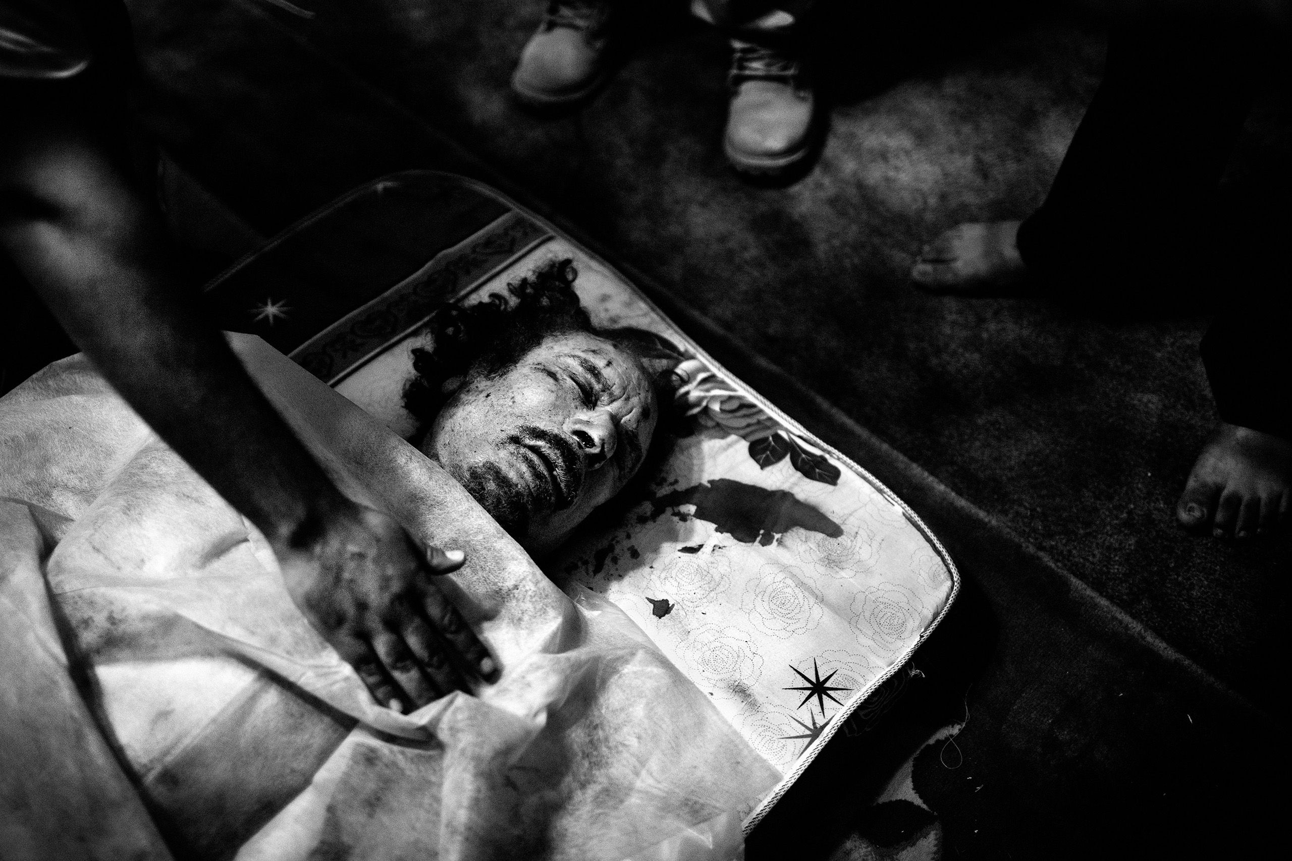 The corpse of Libyan leader Muammar Gaddafi in a rebel's home in Misurata, Libya,  Oct. 20, 2011, the day he was killed.
