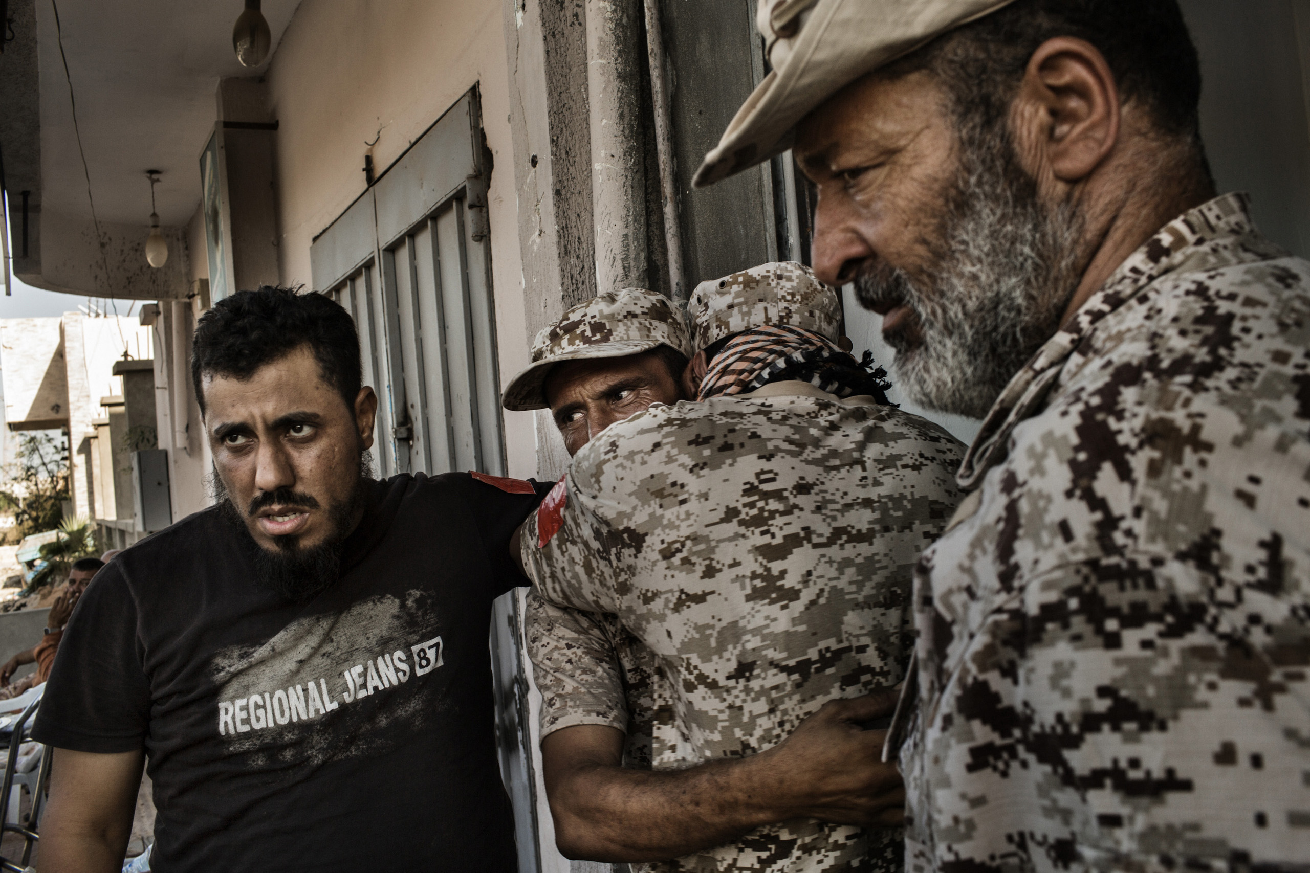 Pro-Libyan government fighters mourn the death of their comrade killed by the Islamic State (ISIS),  Sirte, Sept. 22, 2016.