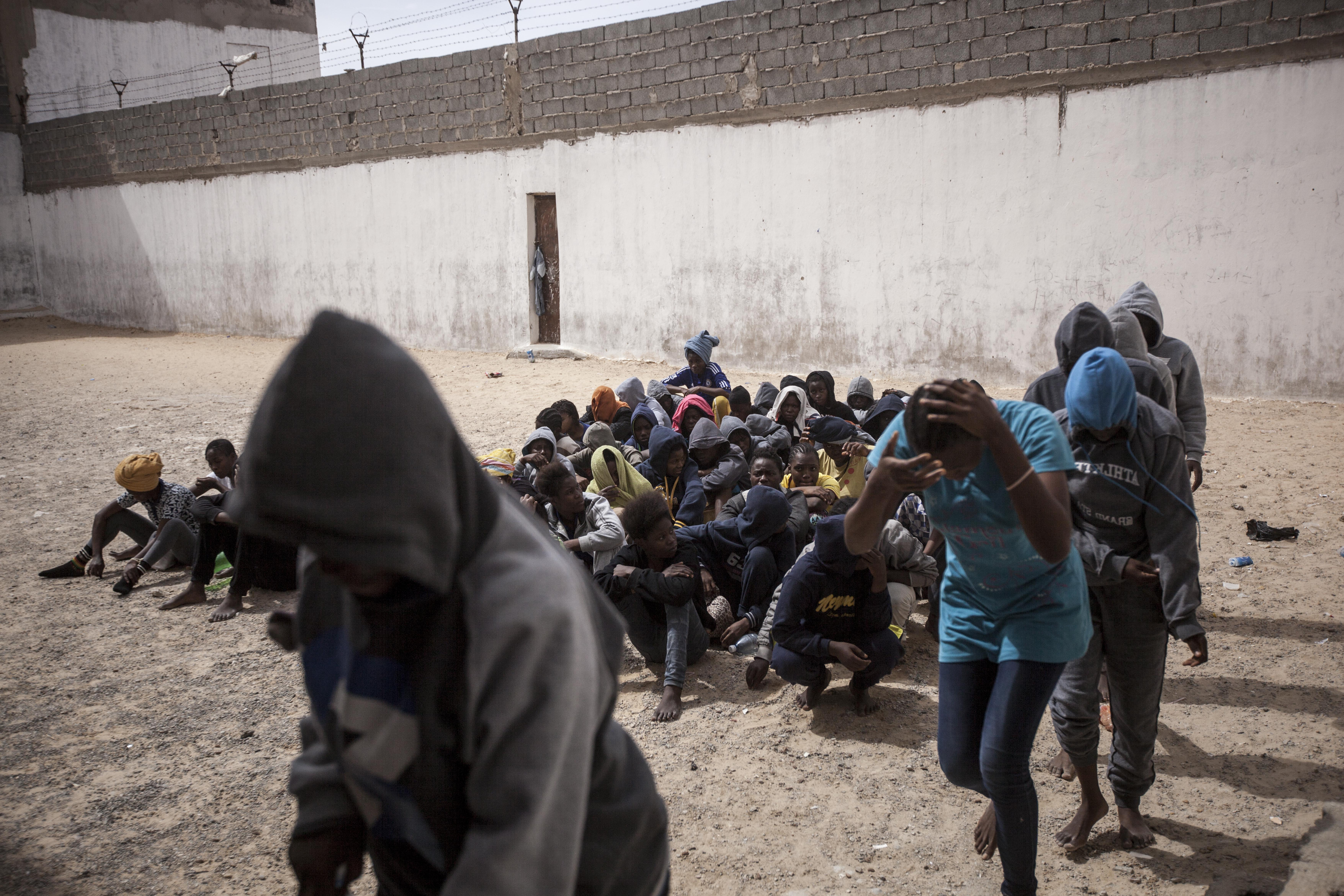Women refugees and migrants queue in the prison yard as they are loaded onto buses to be transferred to another detention center. They were sold by a militia group ruling the Surman detention camp, Libya.