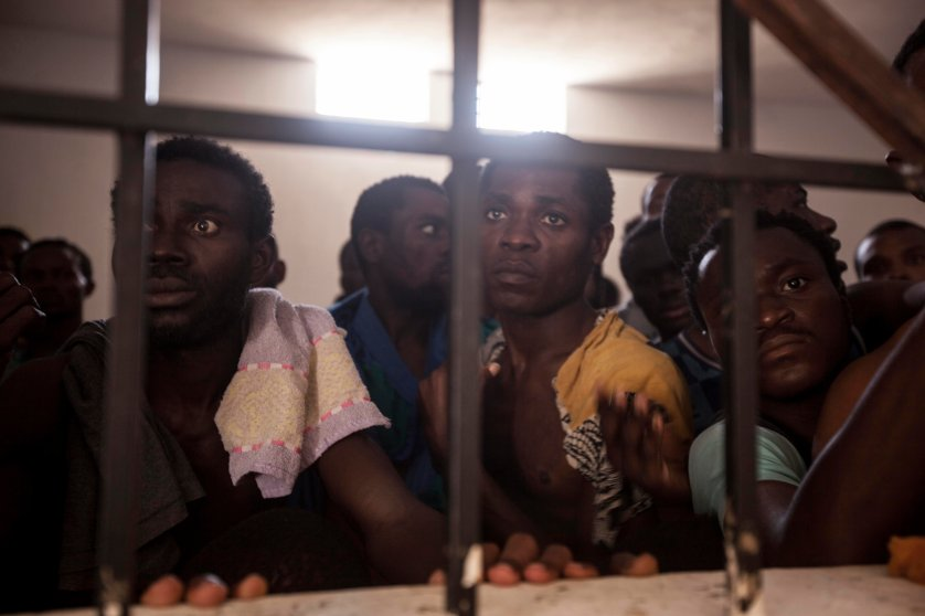 Sub-Saharan migrants and refugees begging for their release in a detention center in Surman, Libya.