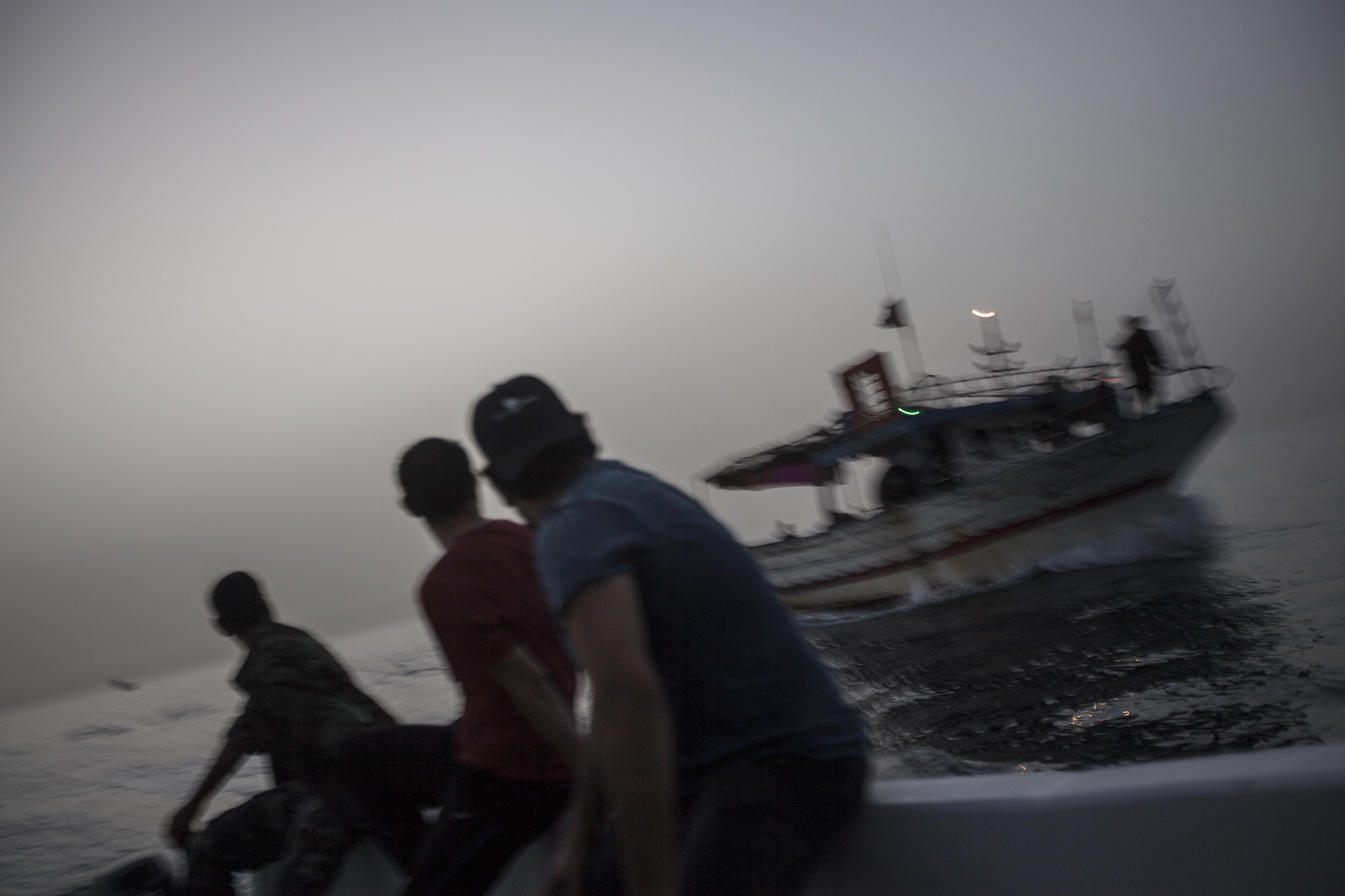 Libyan coastguards escort a boat back to Zawiyah after it was intercepted carrying out illegal activities.