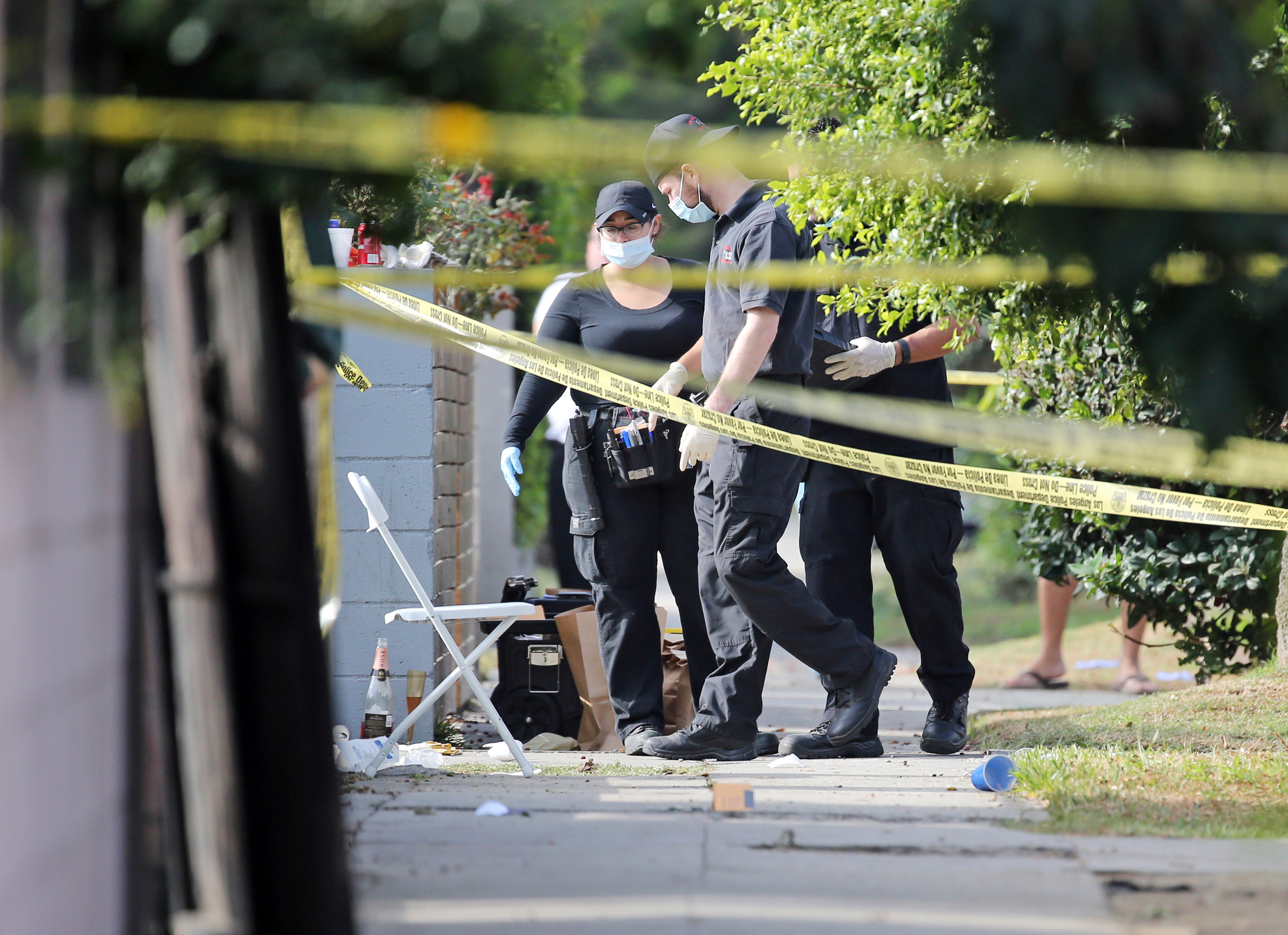 Los Angeles police investigators work the scene of a fatal shooting in the Crenshaw District neighborhood of Los Angeles on Oct. 15, 2016.