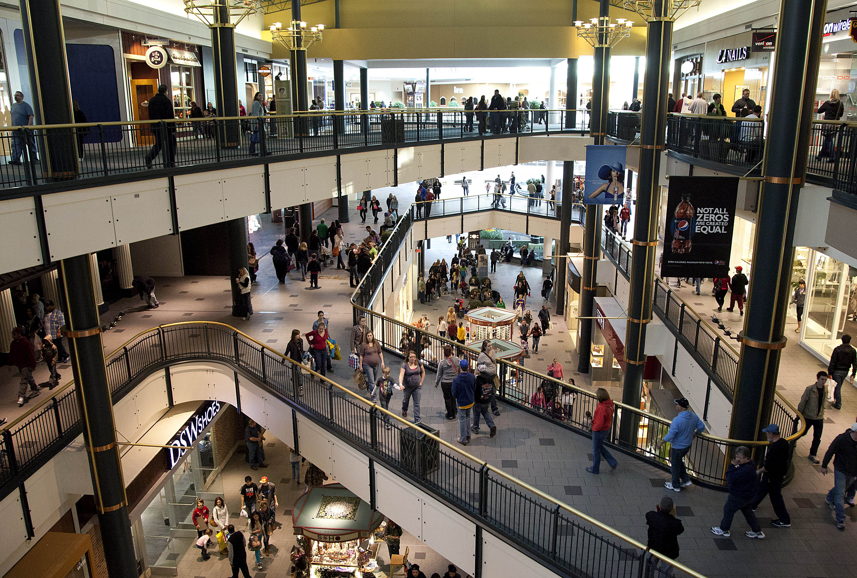 Shoppers walk around the Mall of America in Bloomington, Minn., on Feb. 25, 2012.