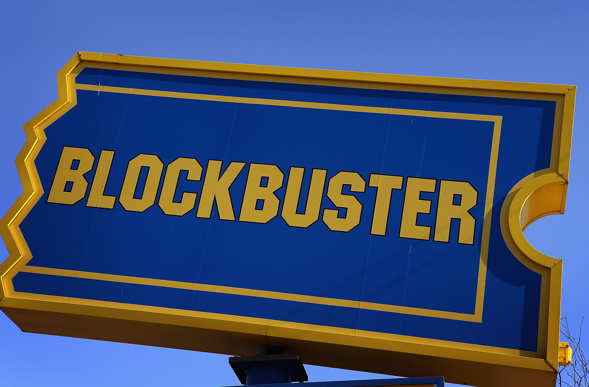 A sign marks the location of a Blockbuster video store on January 22, 2013 in Chicago, Illinois. Dish Network Corp., which owns the video rental chain, says it plans to close about 300 Blockbuster stores across the country, eliminating about 3,000 jobs.   (Photo by Scott Olson/Getty Images)