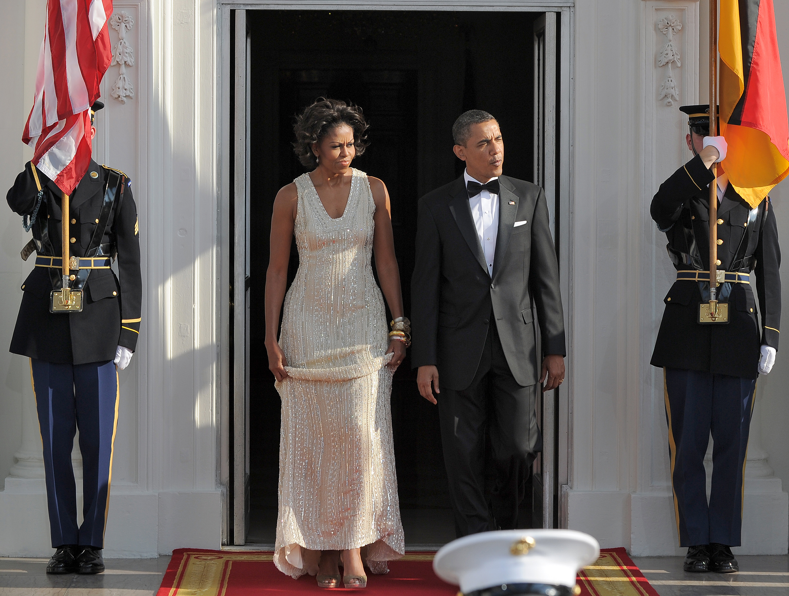 Barack Obama (R) and  Michelle Obama arrive to greet German Chancellor Angela Merkel and her husband Joachim Sauer (not in picture) at the North Portico of the White House in Washington, D.C., on June 7, 2011.