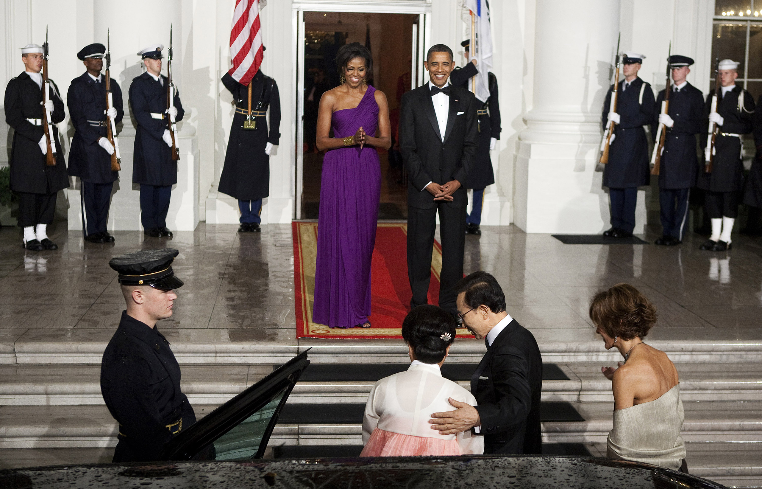 Barack Obama, center right, and Michelle Obama, center left, greet Lee Myung-bak, president of South Korea, foreground center right, and Kim Yoon-ok, First Lady of South Korea, foreground center left, at the North Portico of the White House in Washington, D.C., on Oct. 13, 2011.