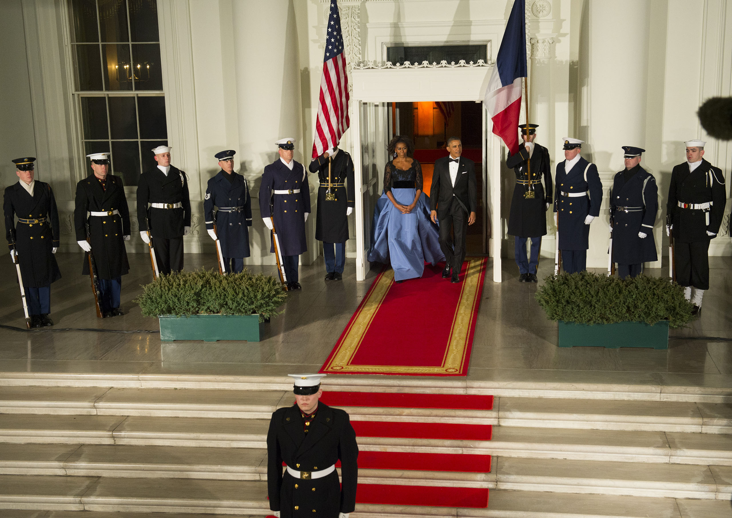 President Francois Hollande of France are greeted by Michelle Obama and Barack Obama as he arrives at the North Portico for a state dinner at the White House in Washington, D.C., on Feb. 11, 2014.