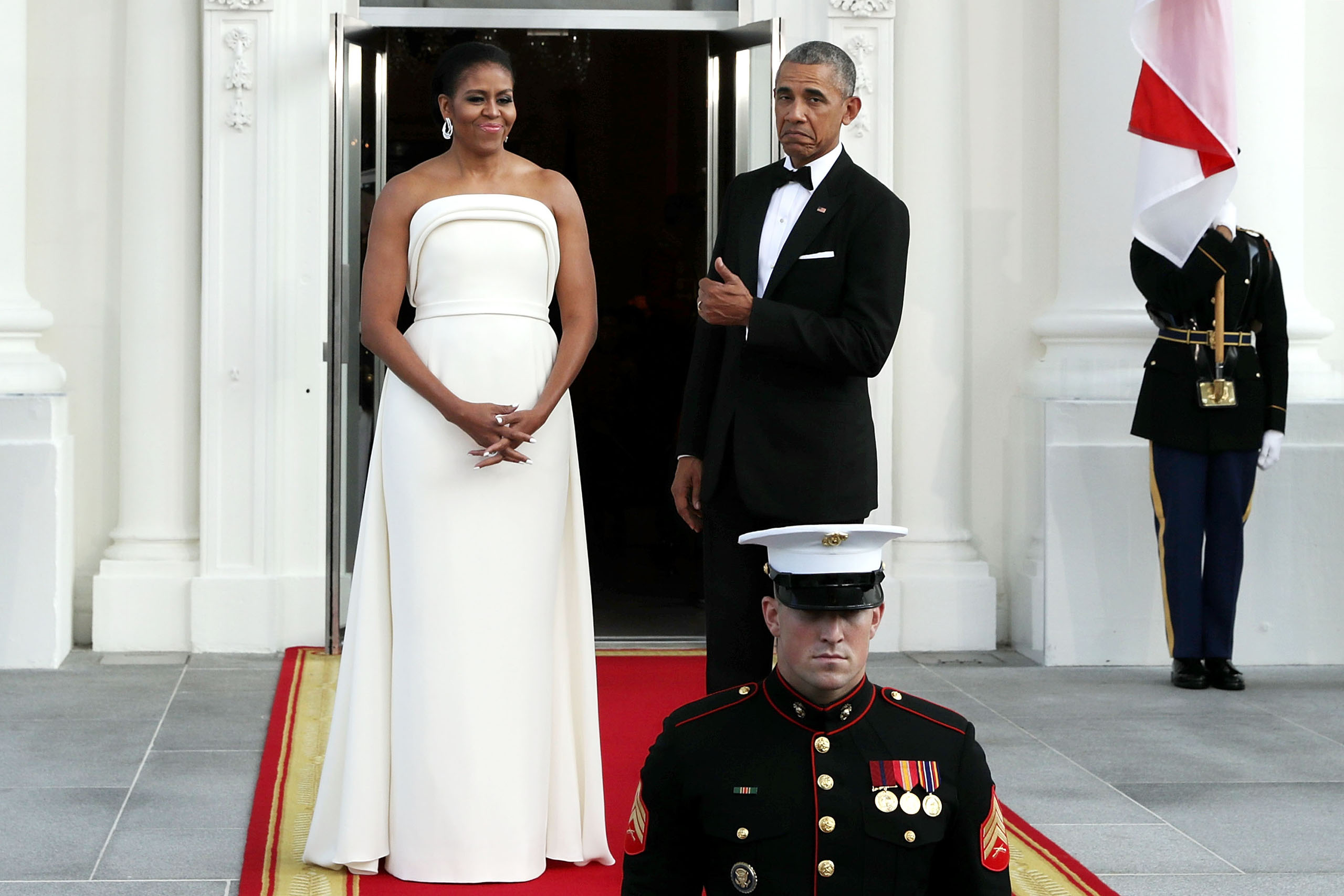 Michelle Obama and Barack Obama wait for the arrival of  Prime Minister Lee Hsien Loong of Singapore and his wife Ho Ching on the North Portico of the White House in Washington, D.C., on Aug. 2, 2016.