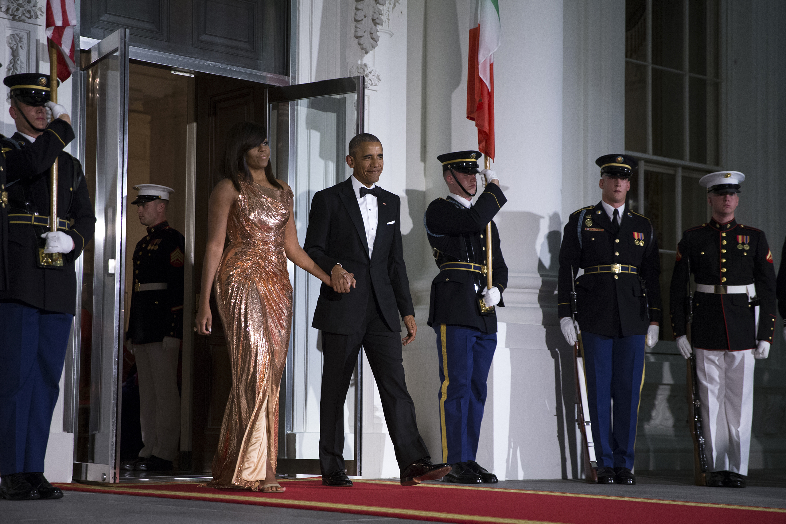 Barack Obama and Michelle Obama walk outside to greet Italian Prime Minister Matteo Renzi and Italian First Lady Agnese Landini prior to the state dinner at the White House in Washington, D.C., on Oct. 18, 2016.