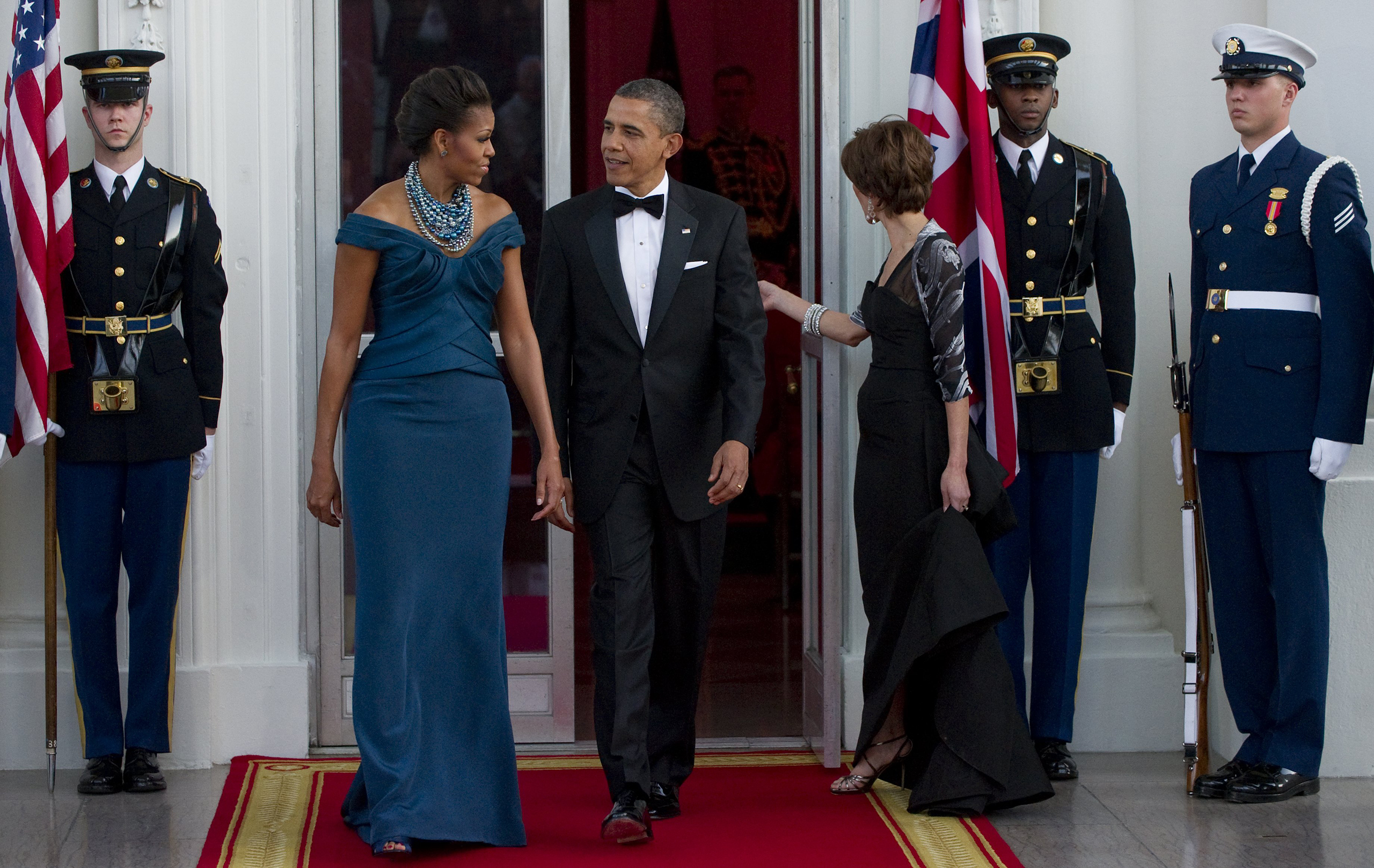 Barack Obama and  Michelle Obama await the arrival of British Prime Minister David Cameron and his wife, Samantha Cameron, prior to a state dinner as part of an official visit on the North Portico of the White House in Washington, D.C., on March 14, 2012.