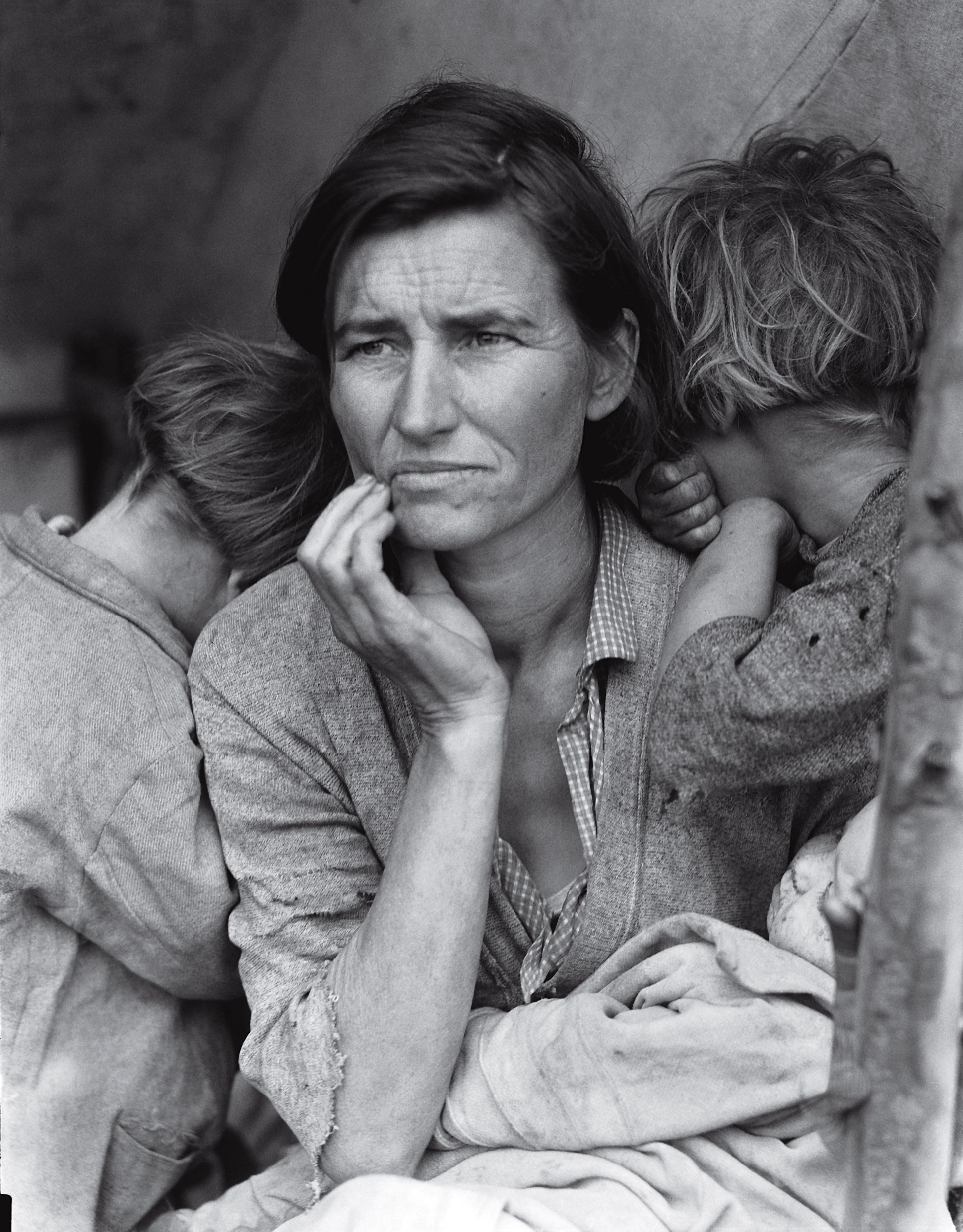 Florence Thompson with three of her children in a photograph known as  Migrant Mother.  1936.